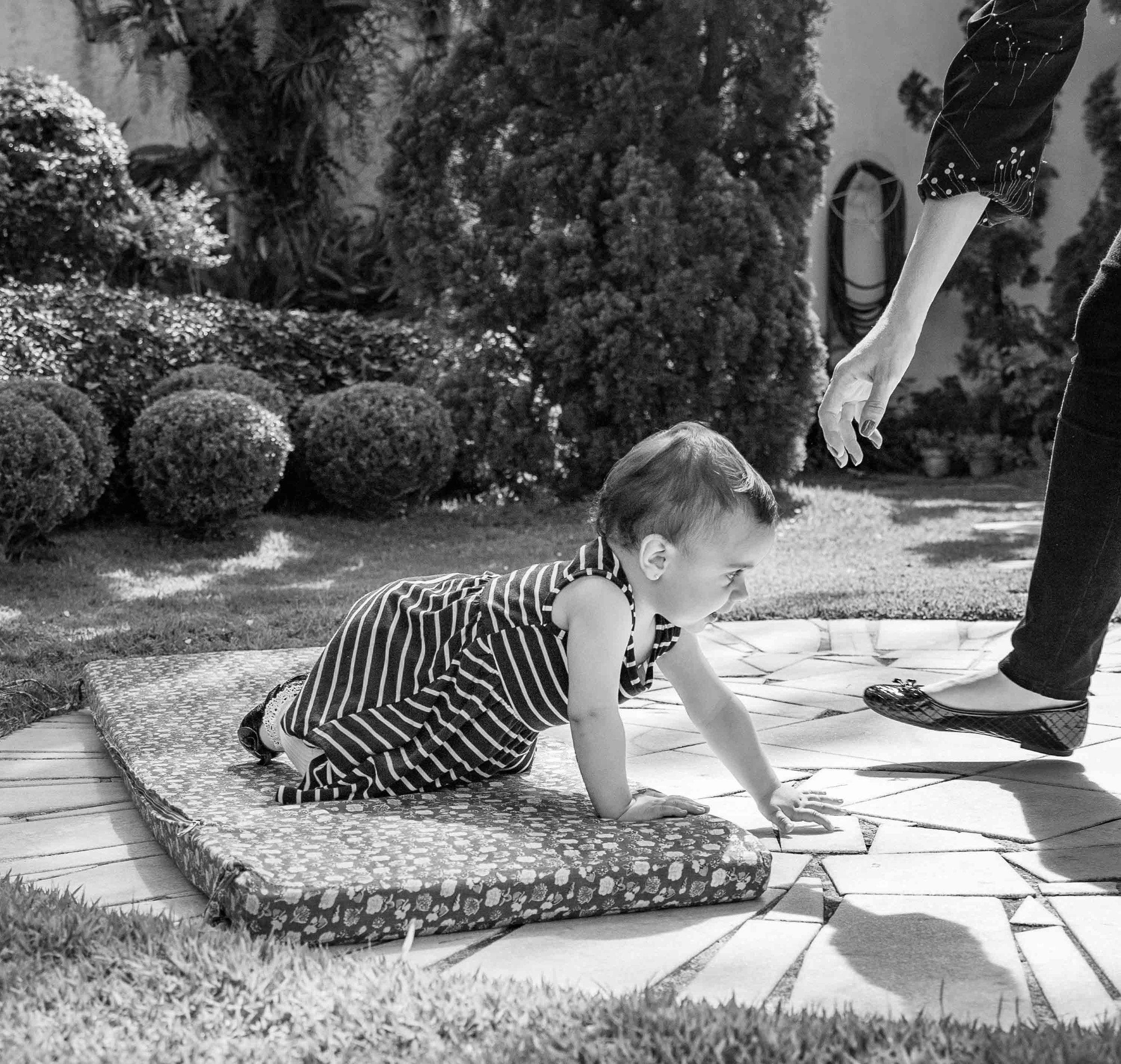 baby-girl-crawling-mother.jpg