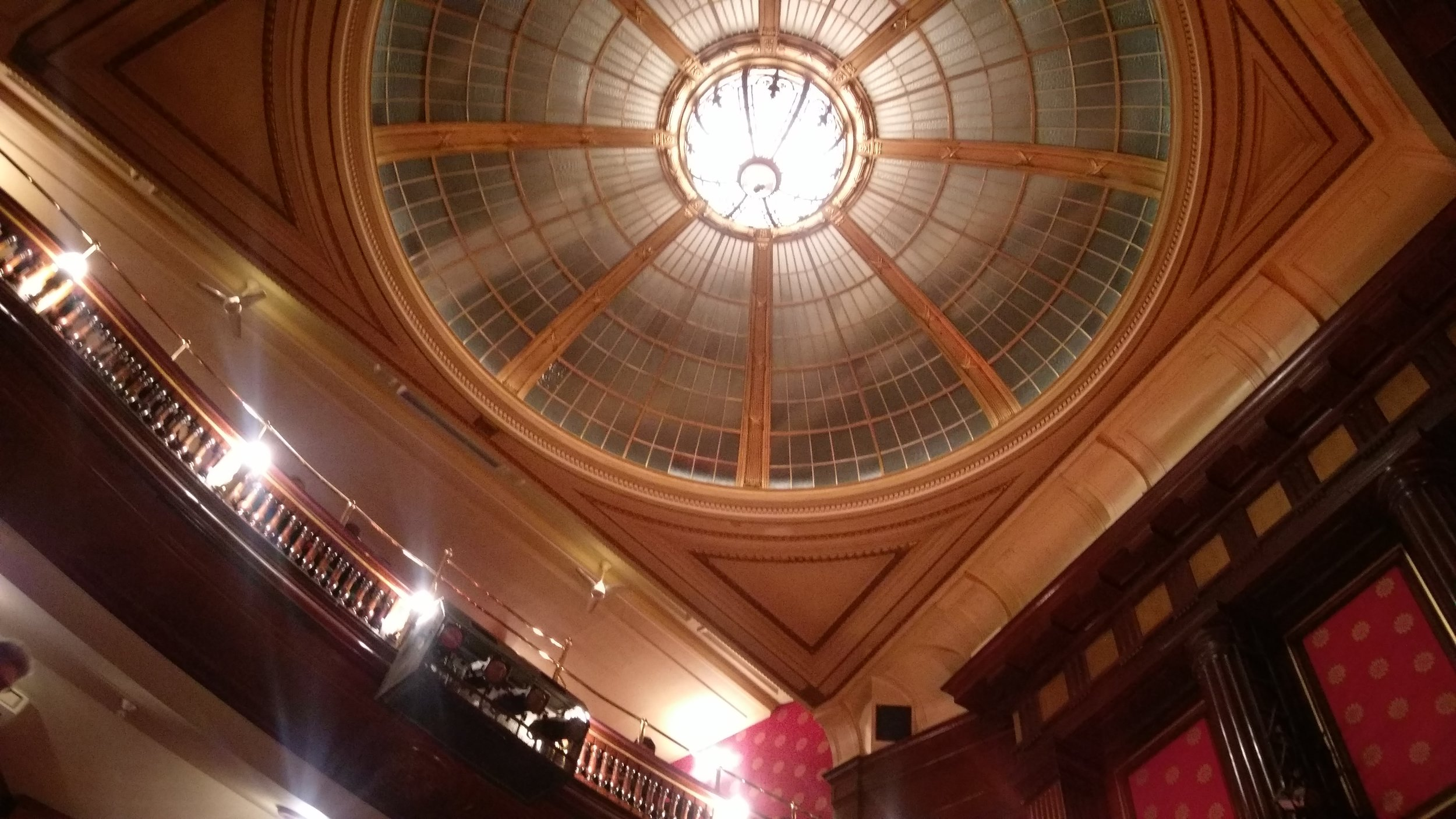The domed ceiling at St Martins Theatre. What's up there? I want to know!
