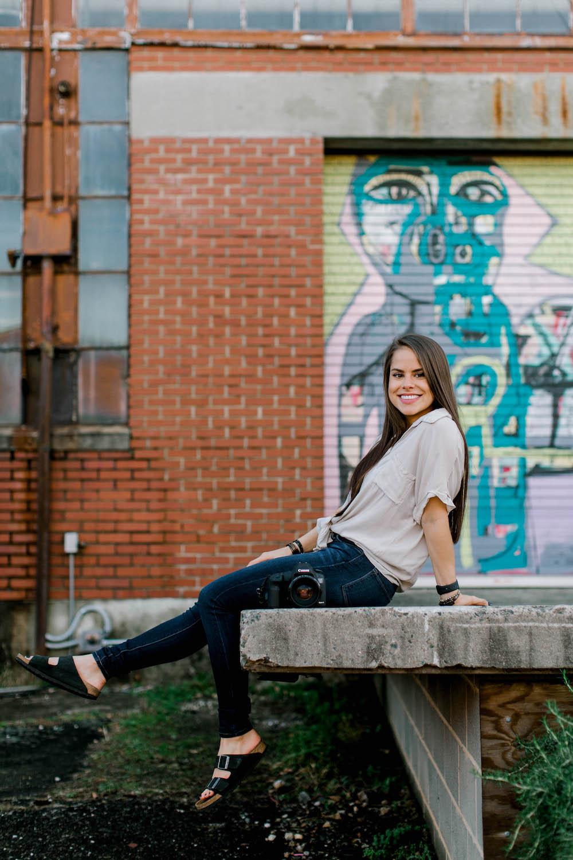 stephanie bailey sitting on an edge.jpg