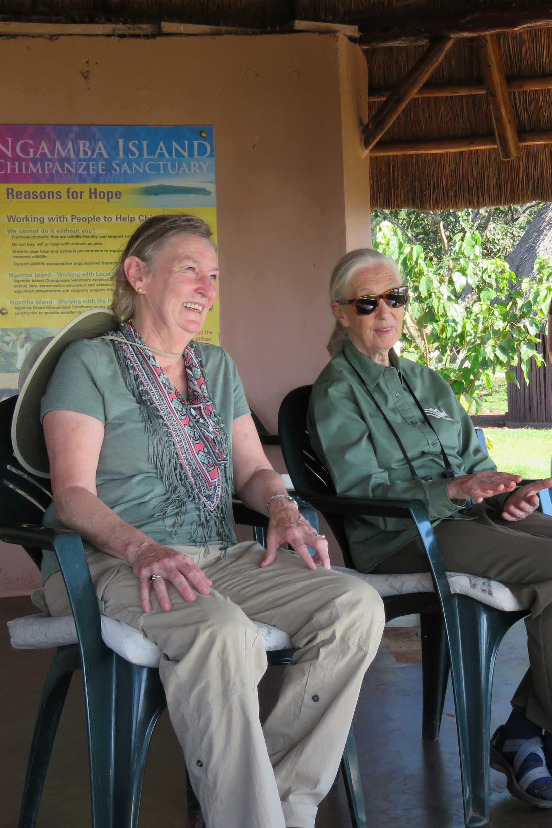 Dr. Merrick relaxes with Dr. Jane Goodall at Ngamba Island Chimpanzee Sanctuary, Uganda, June 2018.