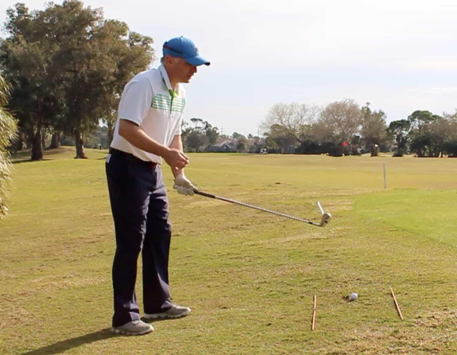 Golf Ball Above Feet Aiming