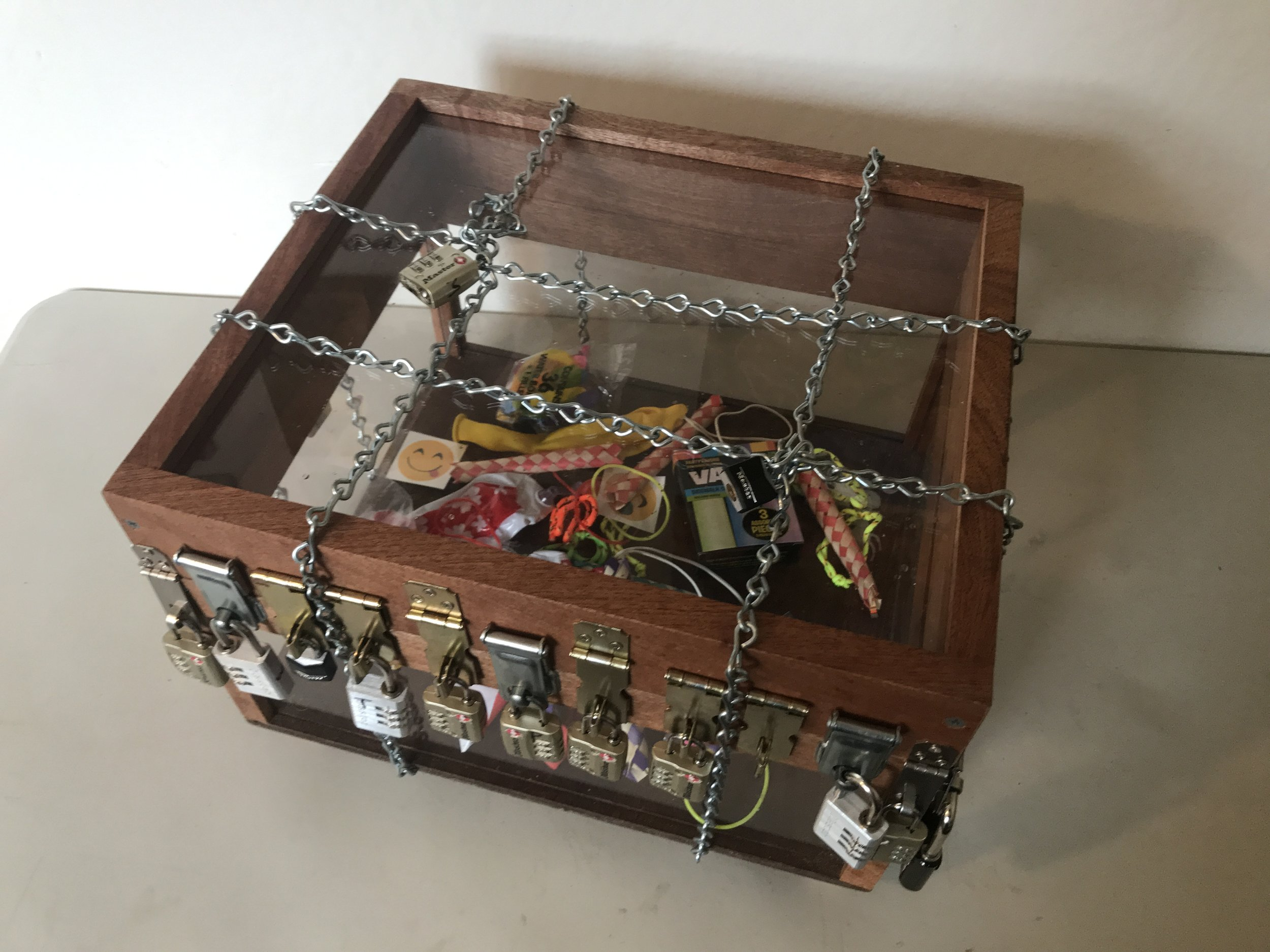 Clear Puzzle Box - Hands down one of the most popular games. This clear box holds a tantalizing prize just out of reach. It works well to hind clues all around the event and let people hunt them down one by one to claim their prize.