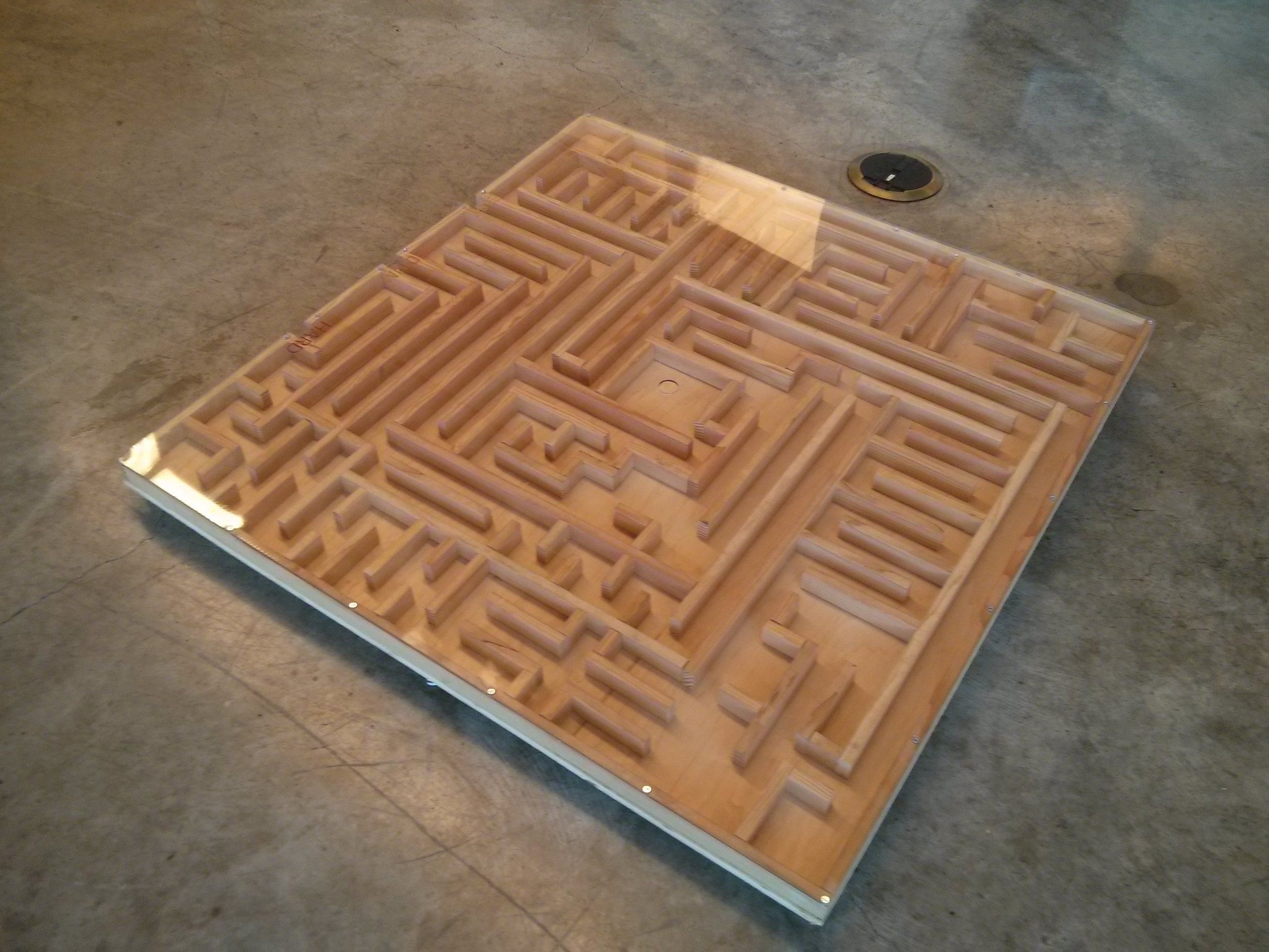 Maze Game - Go ahead stand on it. Guide the marble through this labyrinth. Get a special friend and do it together. You might need to get a little close.