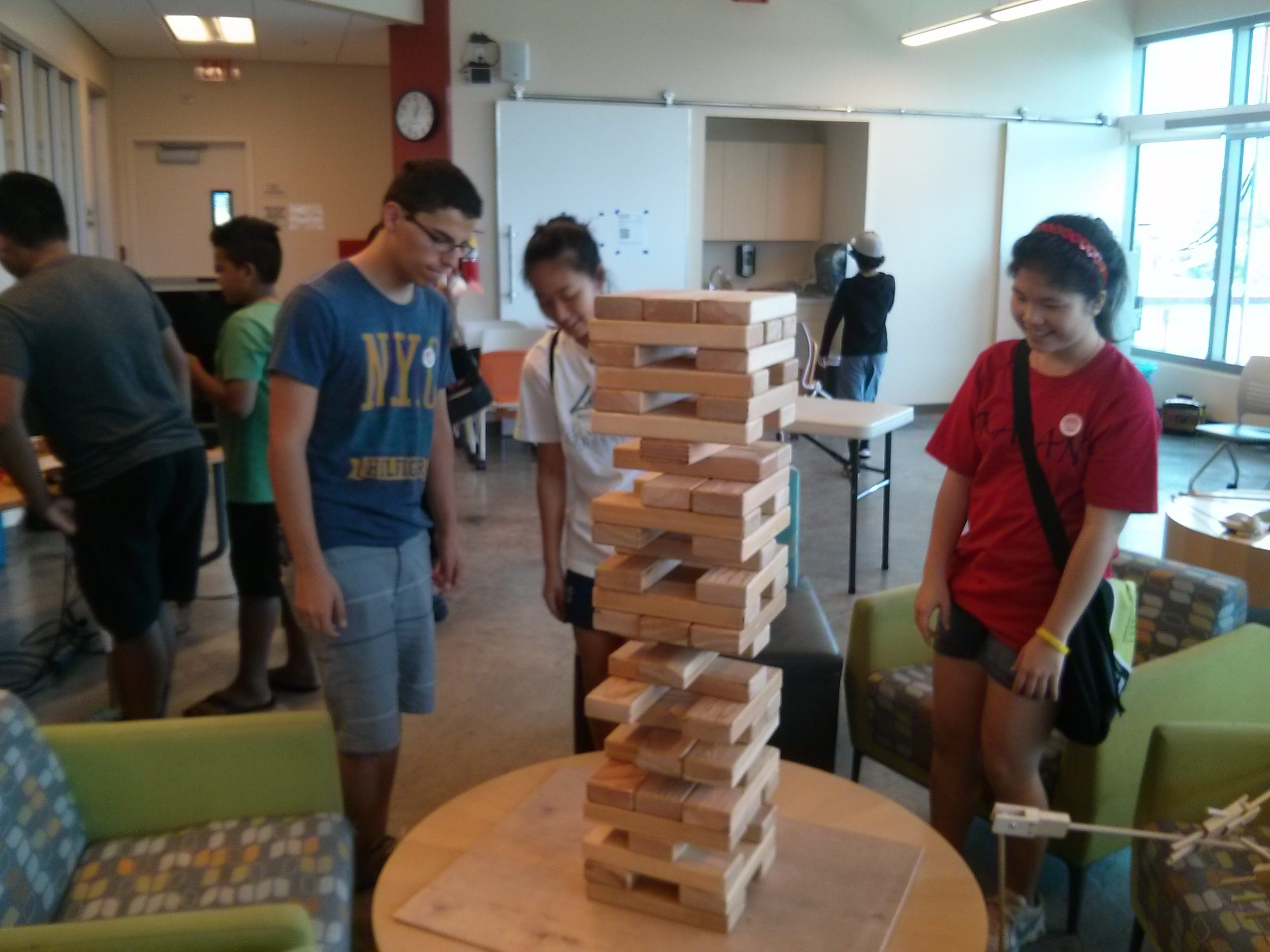 """Block Tower - This game is in no way Jenga. """"Jenga"""" is owned by Pokonbe Associates and the good people there would never sue a small business like """"Puzzle Company"""" for trade mark infringement."""