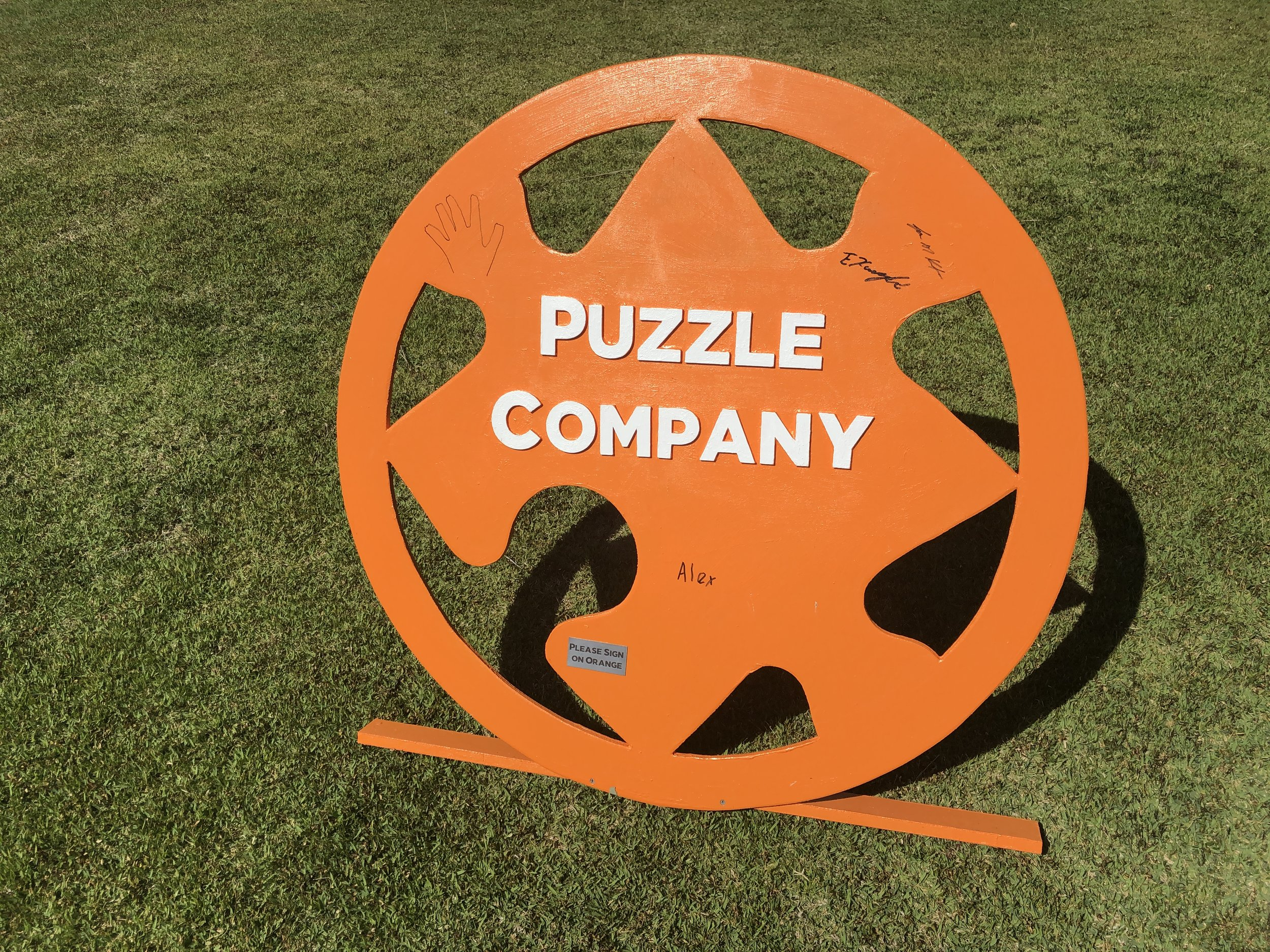 """Puzzle COmpany Logo - Even our signage is interactive. We are asking everyone to """"sign our sign"""". That's not confusing at all grab a sharpie and make it happen."""