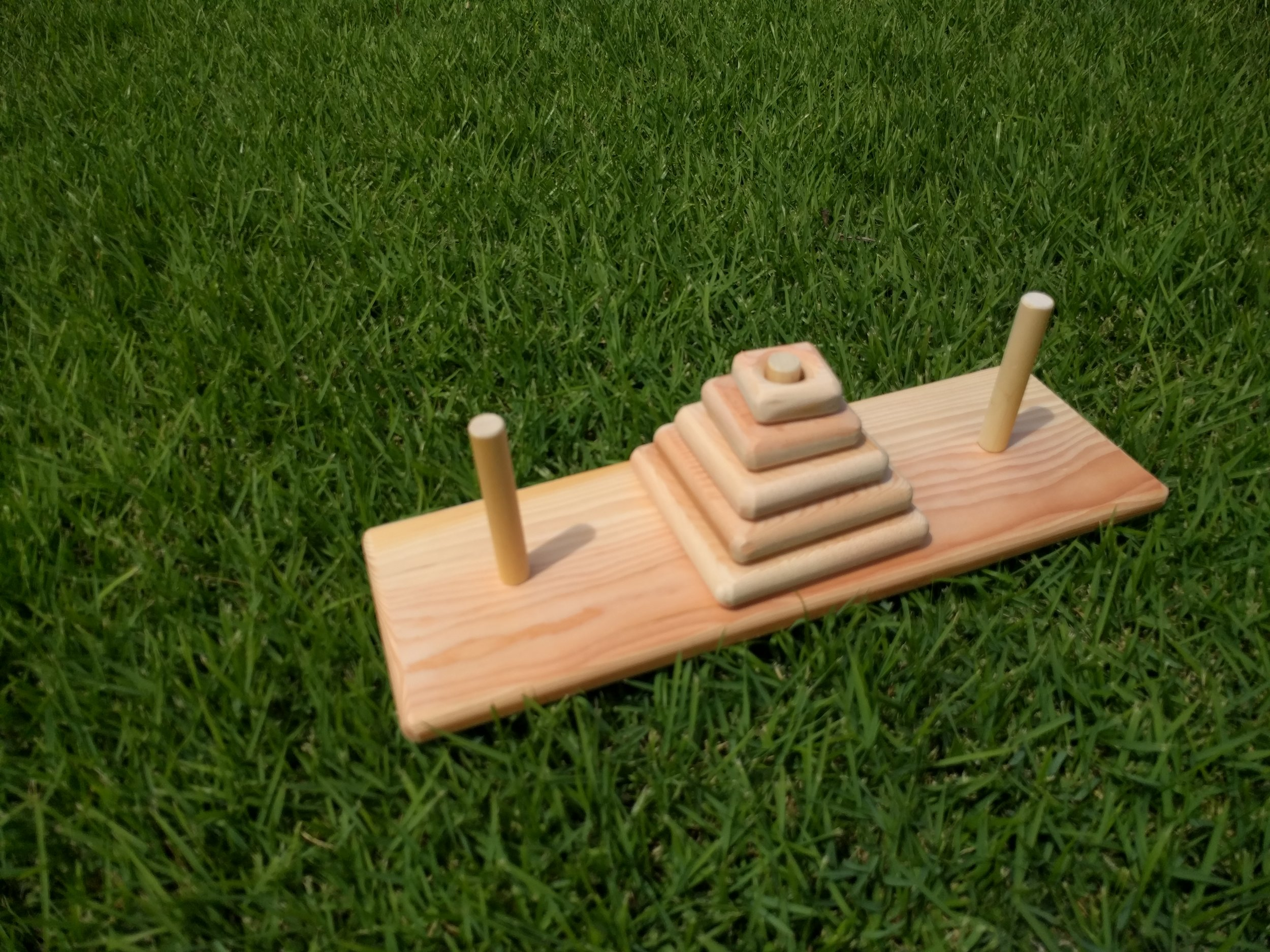 Tower Of Hanoi - This puzzle is simple. Start with all your pieces in the middle and move them to the side. One catch though you can only move one piece at a time and you can never put a bigger piece on a smaller piece. GO!