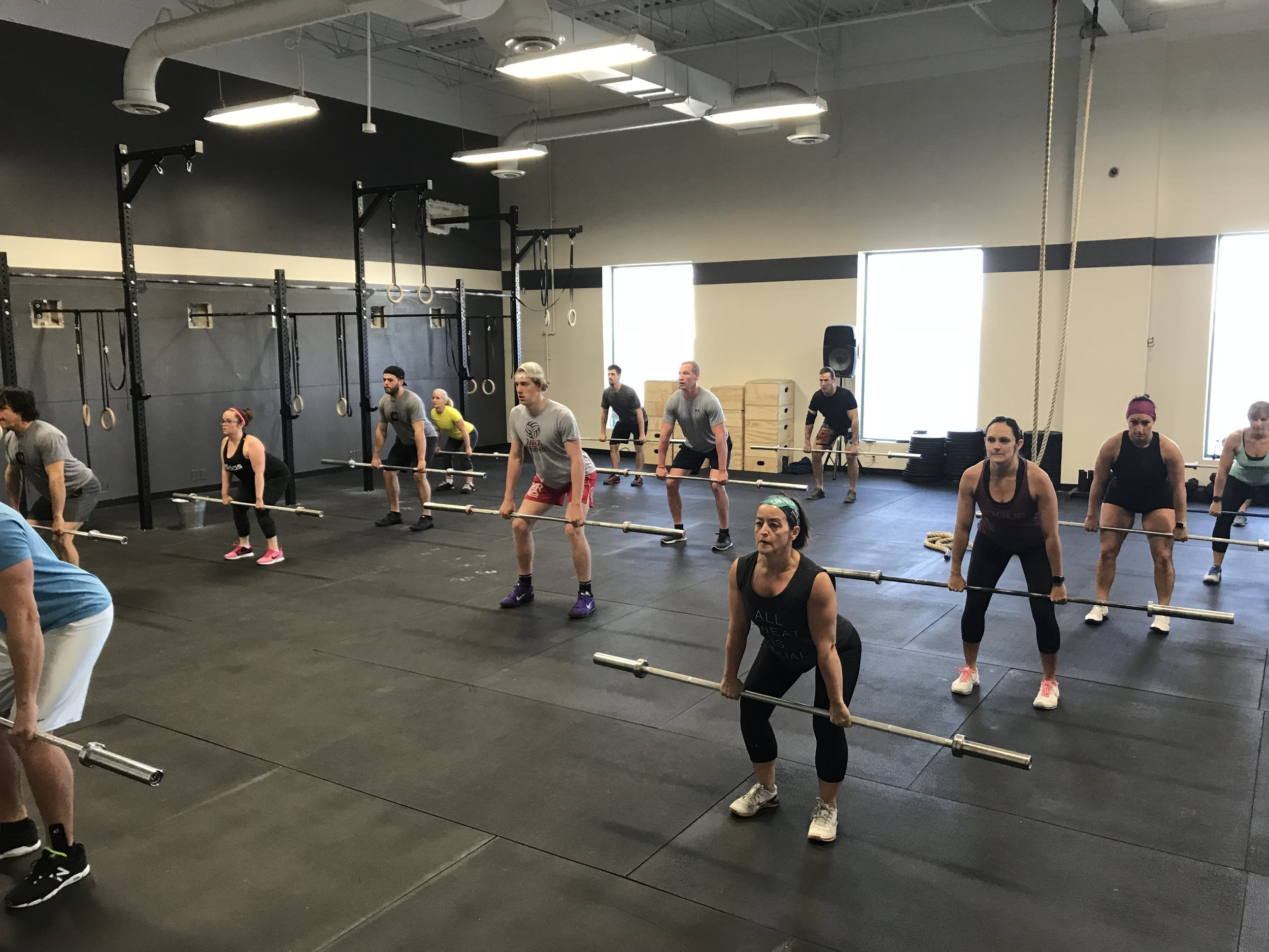 CrossFit + Strength - Highly varied programs that includes cardio, weightlifting, and gymnastics
