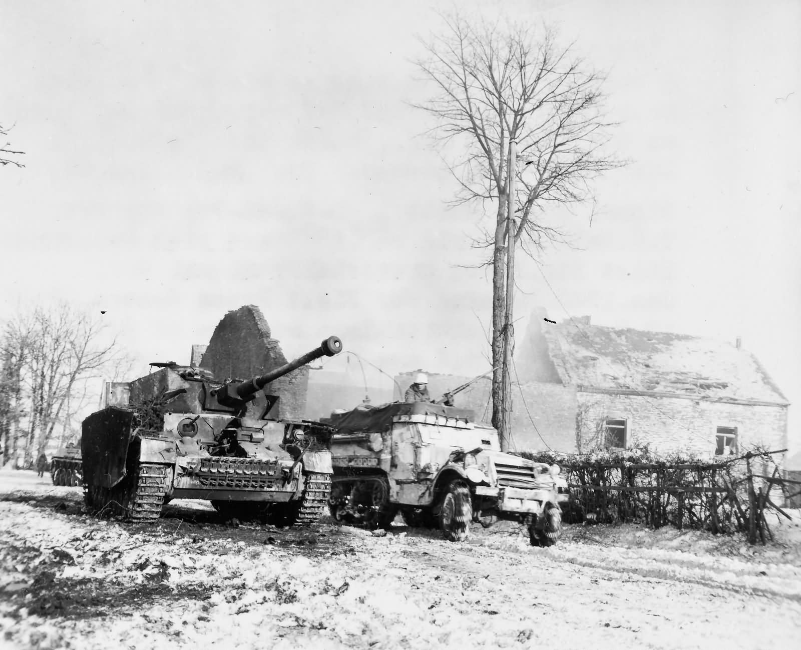 american-m3a1-drives-past-a-destroyed-german-pz-kpfw-iv-j-in-foy-belgium-during-the-battle-of-the-bulge.jpg