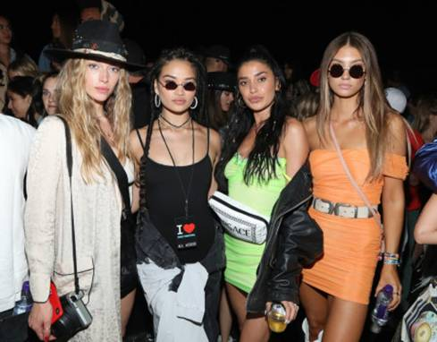 Shanina Shaik, Nicole Williams and guests attend the Levi's Brand Presents Neon Carnival with Bondi Sands and POKÉMON: Detective Pikachu with Penta Water in hand on April 13, 2019.