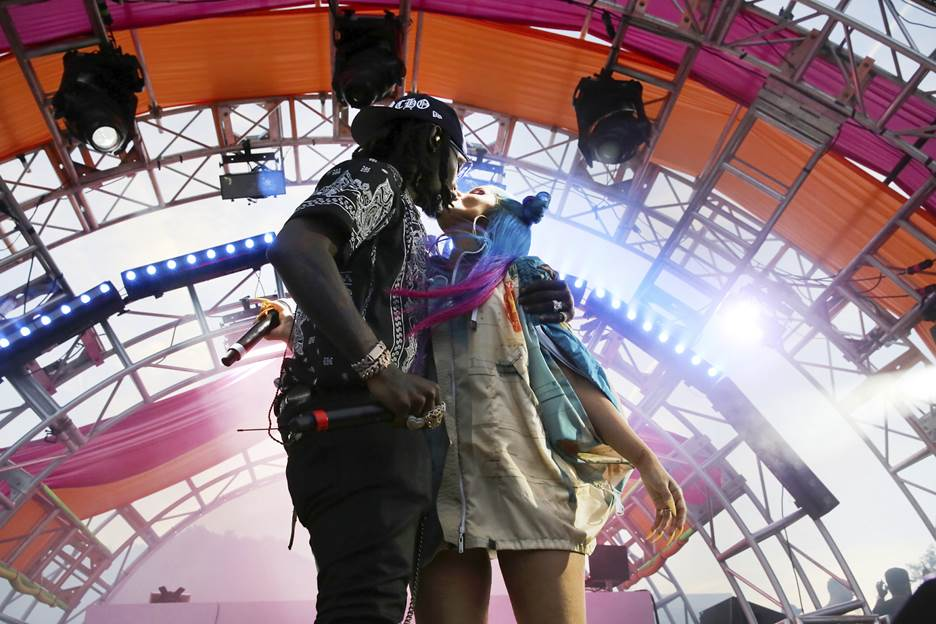 Cardi B and husband Offset share a kiss on stage at #REVOLVEfestival