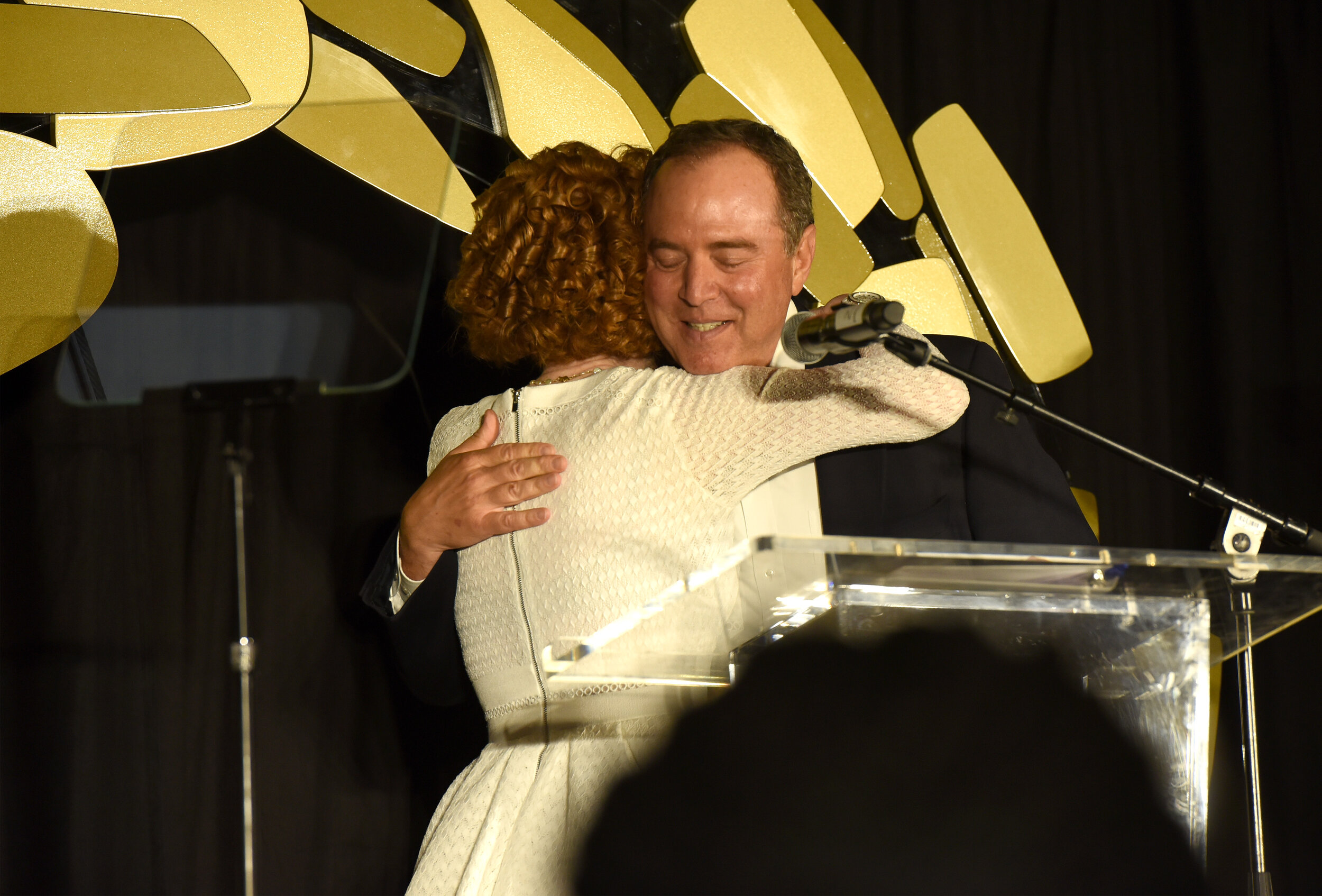 Kathy Griffin and U.S Representative Adam Schiff speak onstage during Los Angeles LGBT Center Gold Anniversary Vanguard Celebration (Photo by Presley Ann_Getty Images).jpg