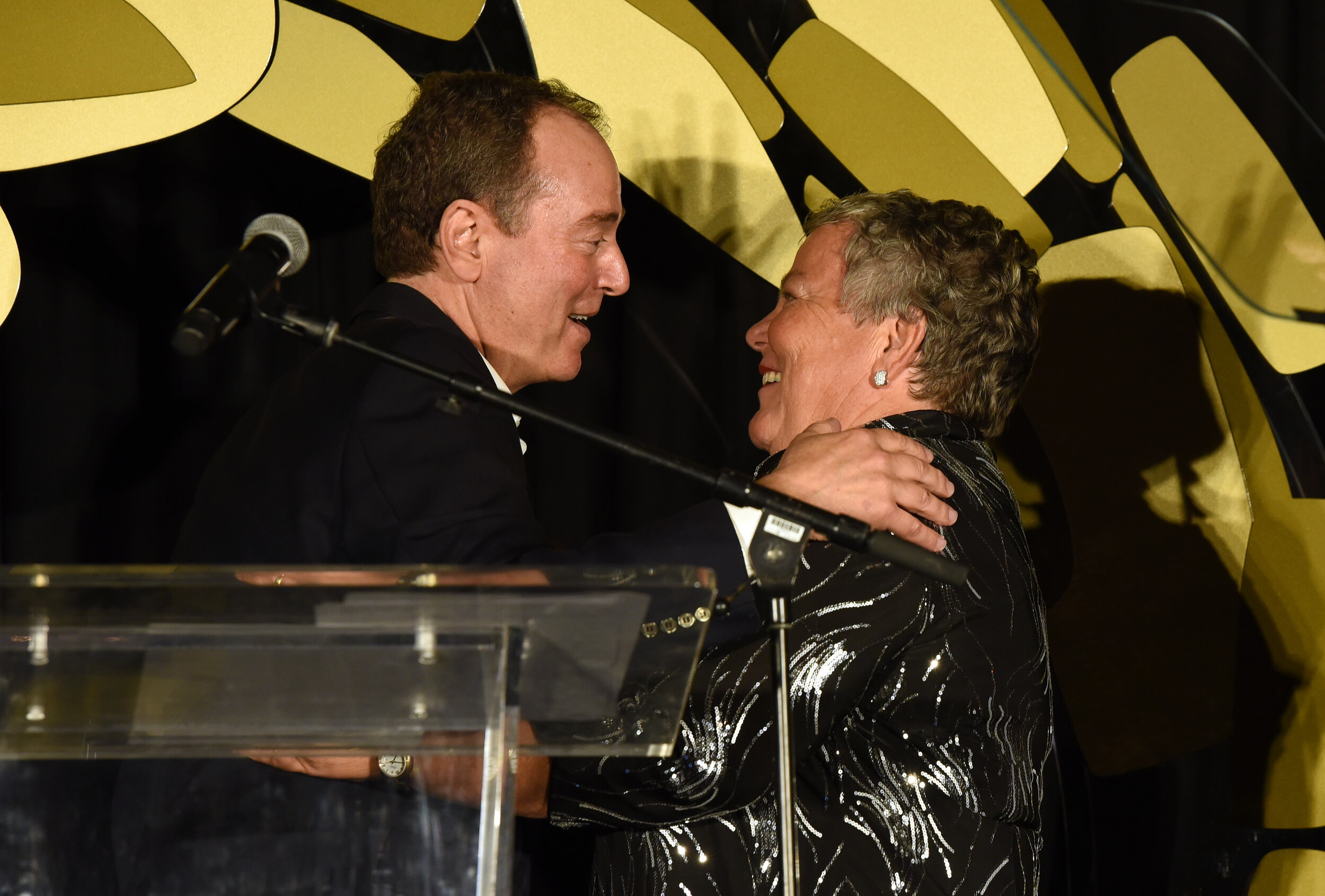 U.S. Representative Adam Schiff and CEO of the Los Angeles LGBT Center Lorri L. Jean speak onstage (Photo by Presley Ann_Getty Images).jpg