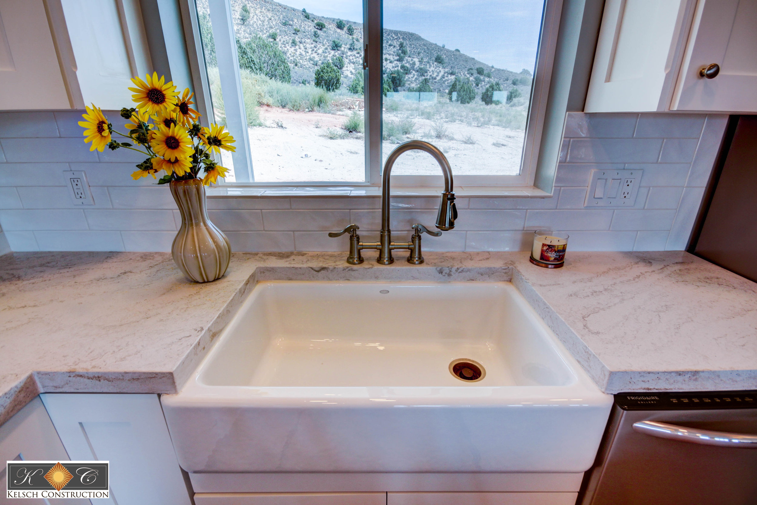 Custom farmhouse sink with concrete counters