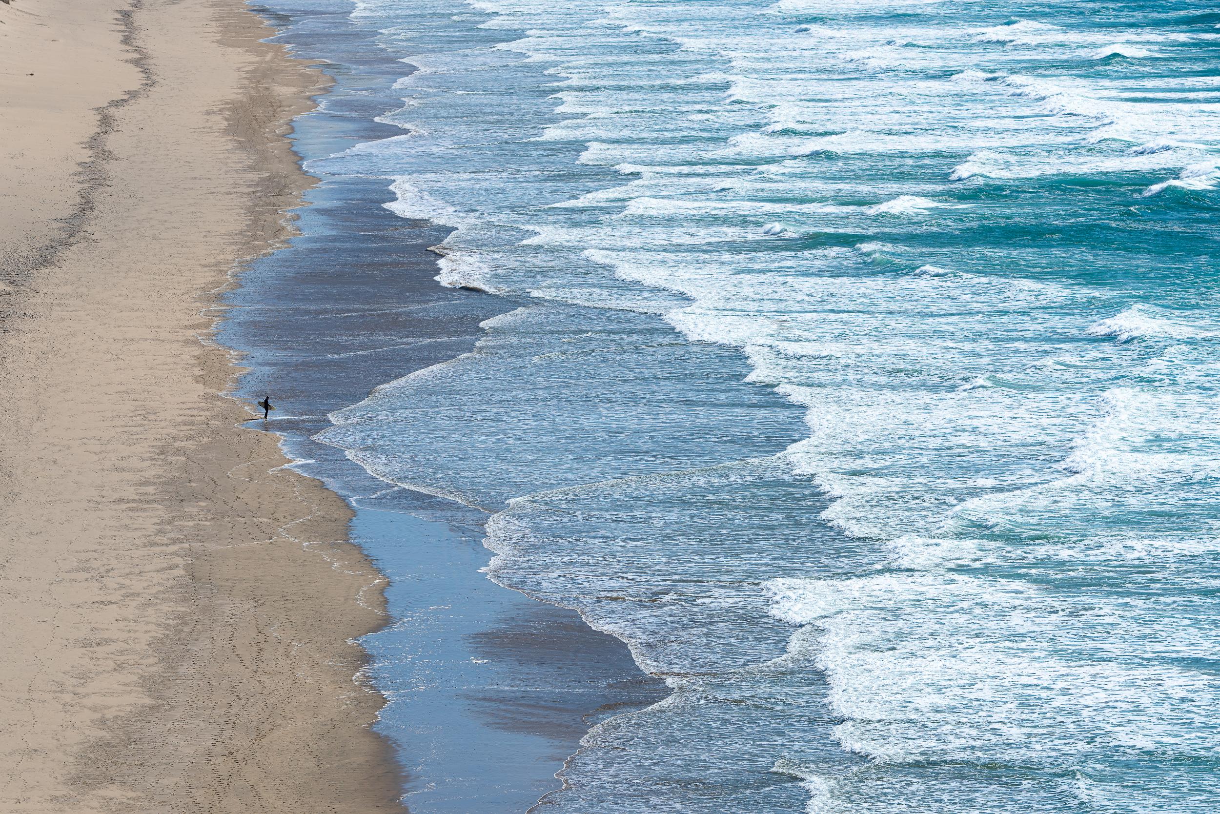 surfer-sand-beach-waves.jpg