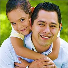 father-with-son-clinging-from-his-neck-from-behind.jpg