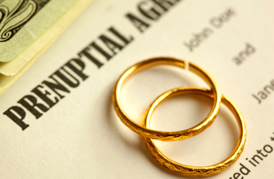 prenuptial-agreement-document-with-two-rings-on-top-of-it.jpg