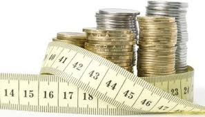towers-of-coins-surrounded-by-a-measuring-tape.jpg