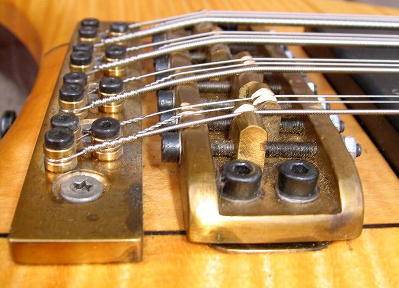 Custom 8-saddle brass bridge and tailpiece.