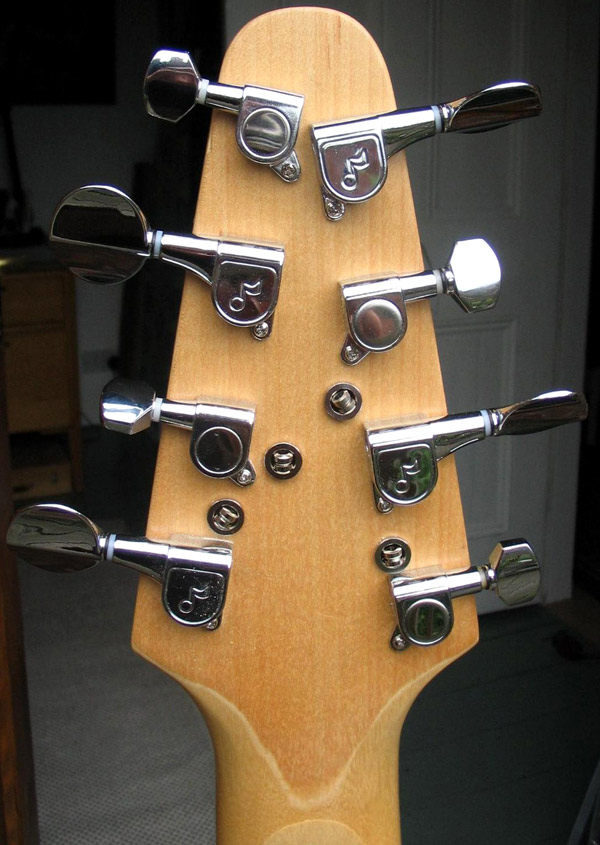 The back of the headstock showing the four string ferrules.