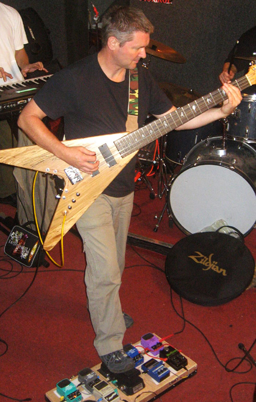 Chris on stage with his custom 12-String bass
