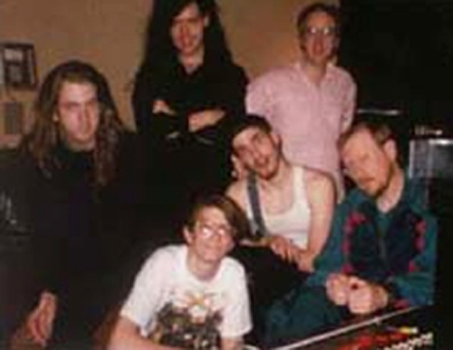 Clockwise from left: Mark Poindexter, Frank Hart, Steve Ames, Sam Taylor, Jonathon Marshall and Len Sonnier in center. Photo from the Atomic Opera site.