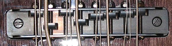 Tune-o-matic style 8-saddle bridge