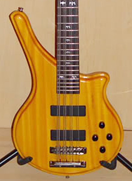 Type 1 has no lower horn and the 4-knob electronics.