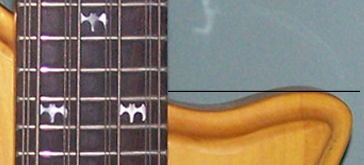 The body on Type 1 basses extends nearly straight down the neck with only a slight dip.