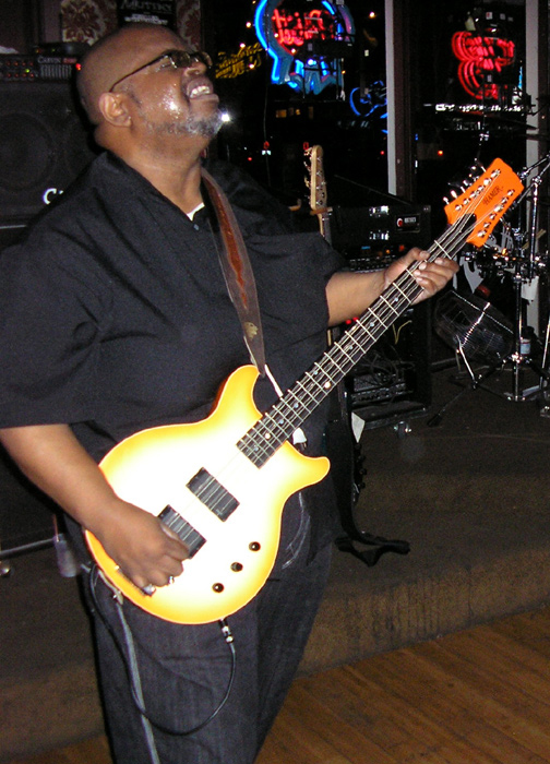 """Odell on stage at The Mutiny in Antioch, California with his Hamer B12M """"Dreamsicle"""" 12-string bass."""
