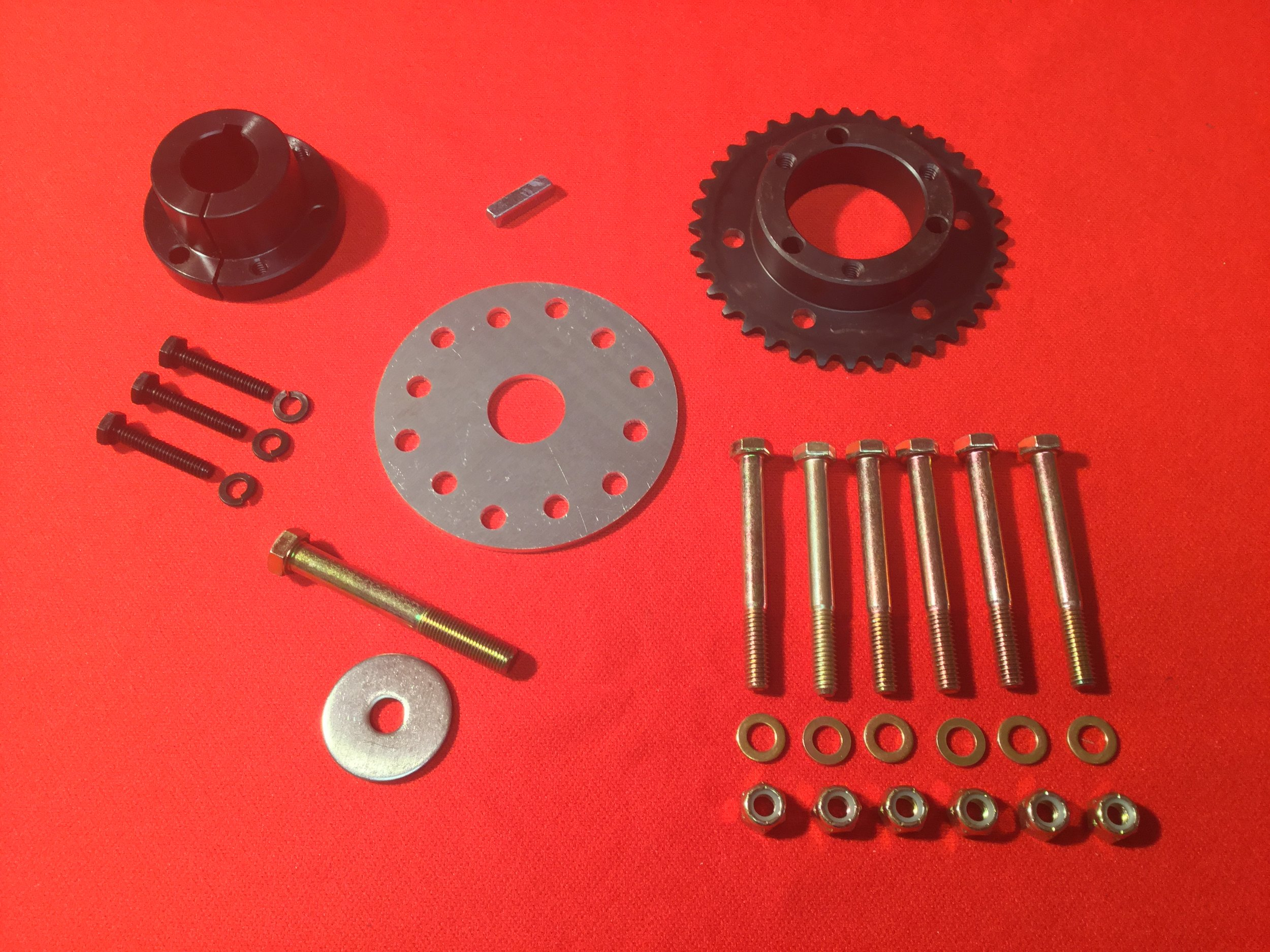 """Prop Flange Kit - Kit includes a taper lock bushing and matching modified sprocket to provide the interface between keyed, straight shaft small gas engines and the Ultra-Prop. Also provided is a """"crush"""" or backing plate, mounting hardware and key. Available for shaft sizes from 3/4"""