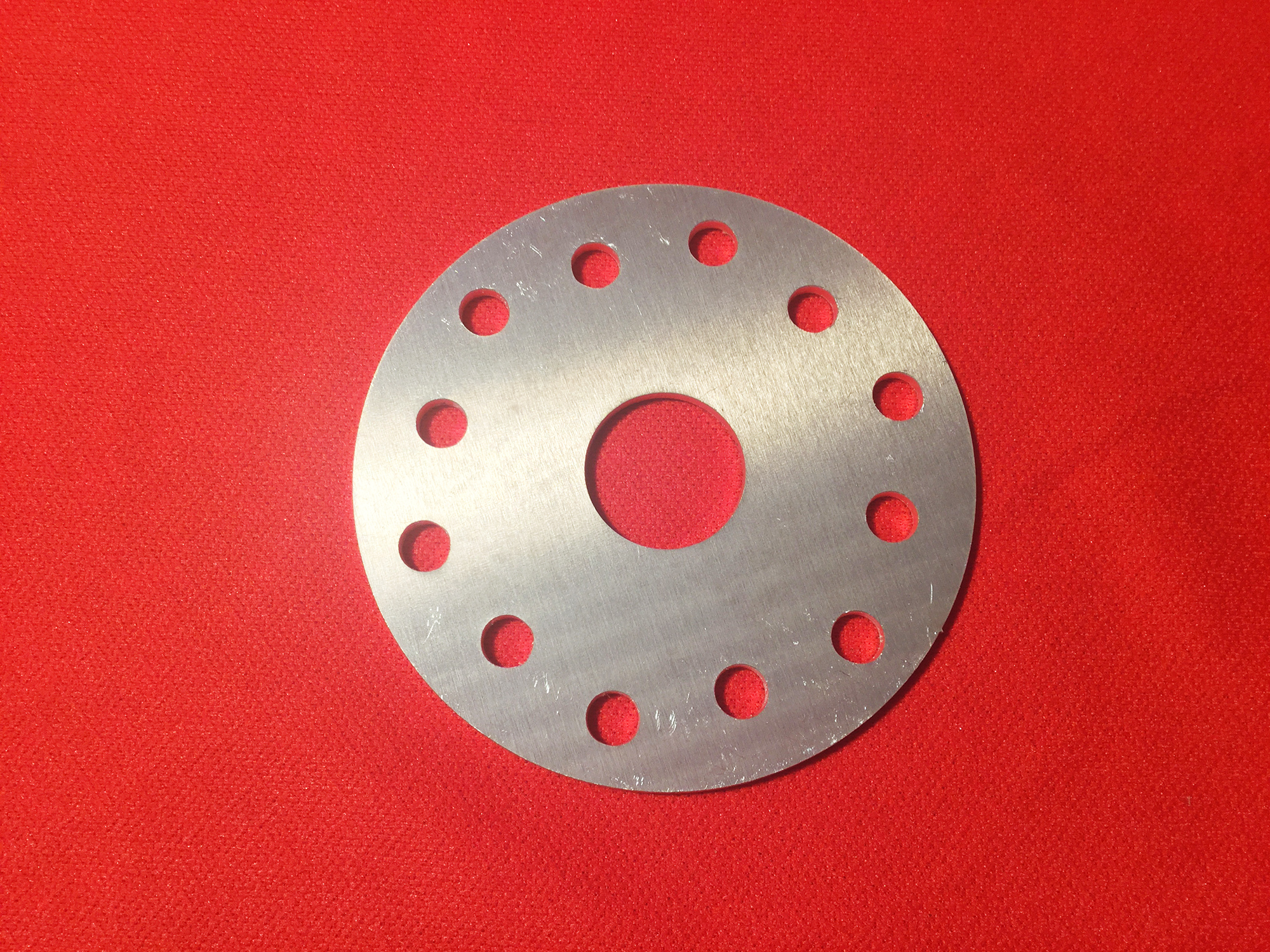 """Crush or Face Plate - 3/16"""" aluminum plate. One-inch center pilot hole. Six, 5/16"""" or 8mm holes on standard Rotax 75mm bolt circle and 2 3/4"""" bolt circle."""