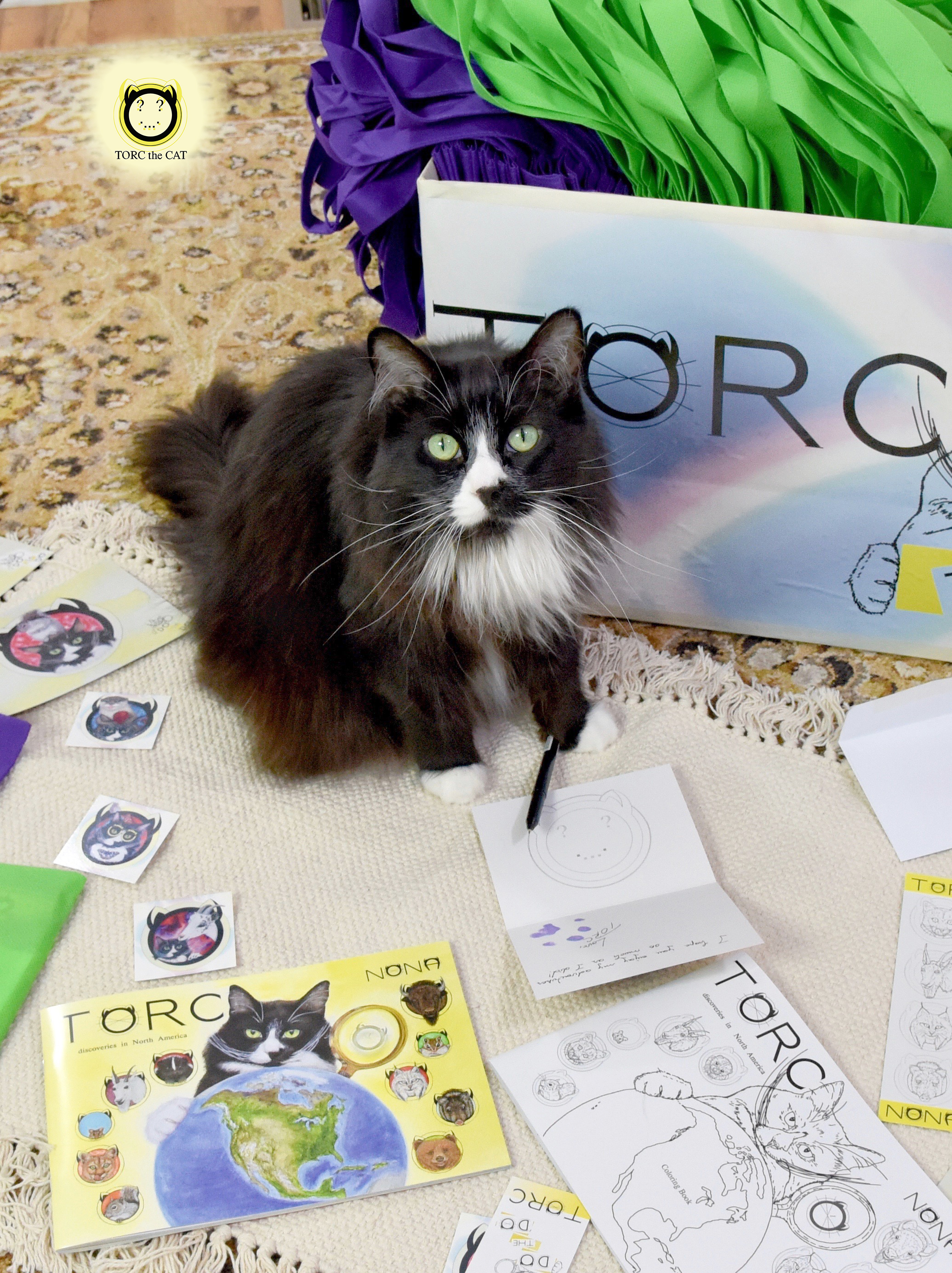 TORC the CAT caught in the process of signing one of the cards included in the gift bags donated to the Sacred Heart Children's Hospital.