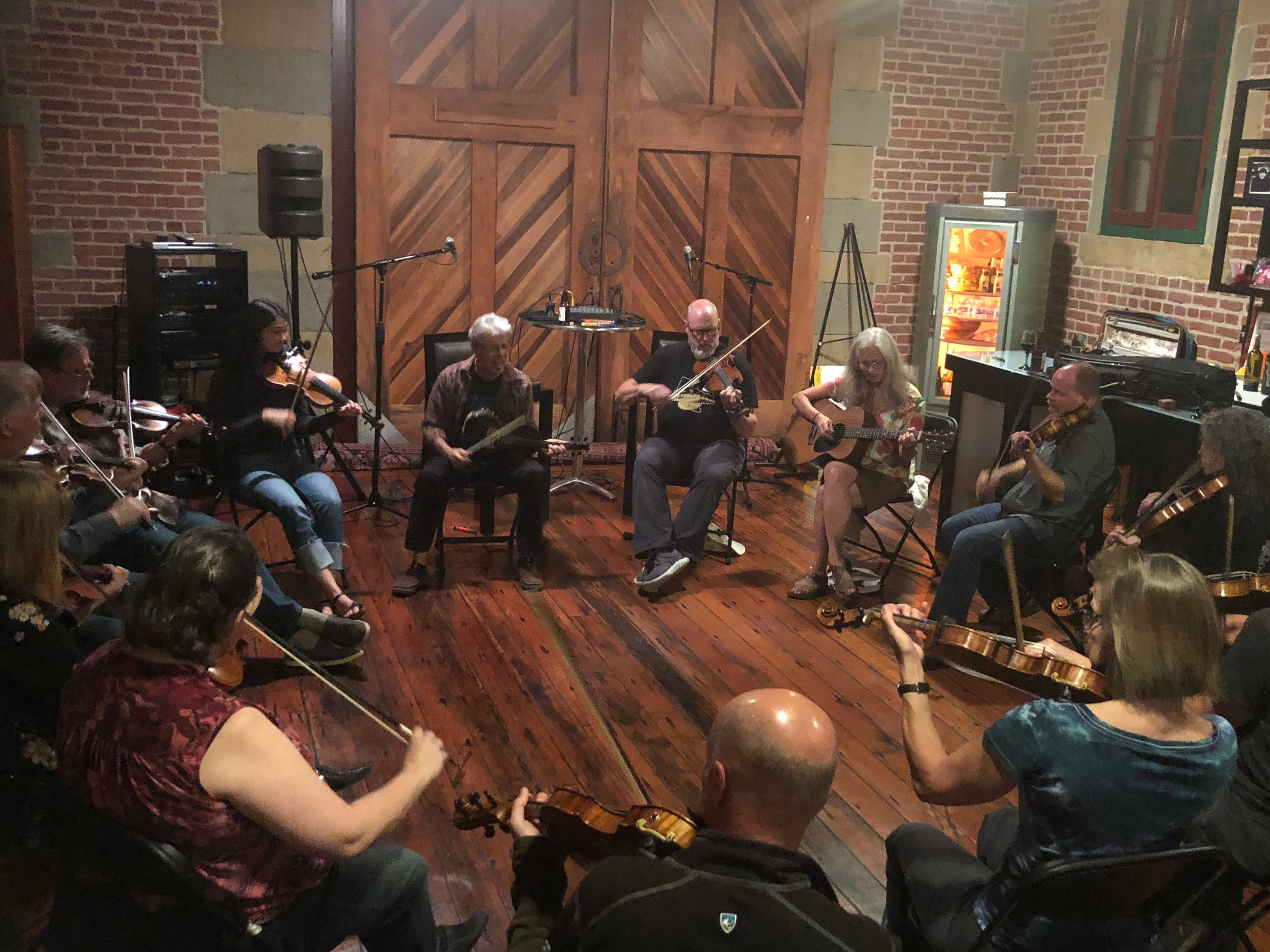 Darol Anger leading a fiddle jam circle.