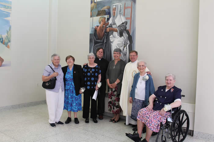 Pictured (L-R) Sr. Pat Curreri, Sr. Veronica Byrne, Sr. Mary Jo O'Connor, Father Tom Poth, SMM, Superior of the Vice-Province of the United States, Montfort Missionaries, Sr. Catherine Sheehan, Daughters of Wisdom, Provincial Leader, Father Luiz Augusto Stefani, SMM, Superior General of the Montfort Missionaries, Sr. Jeannine Boutin, and Sr. Mary Jane Cashin.