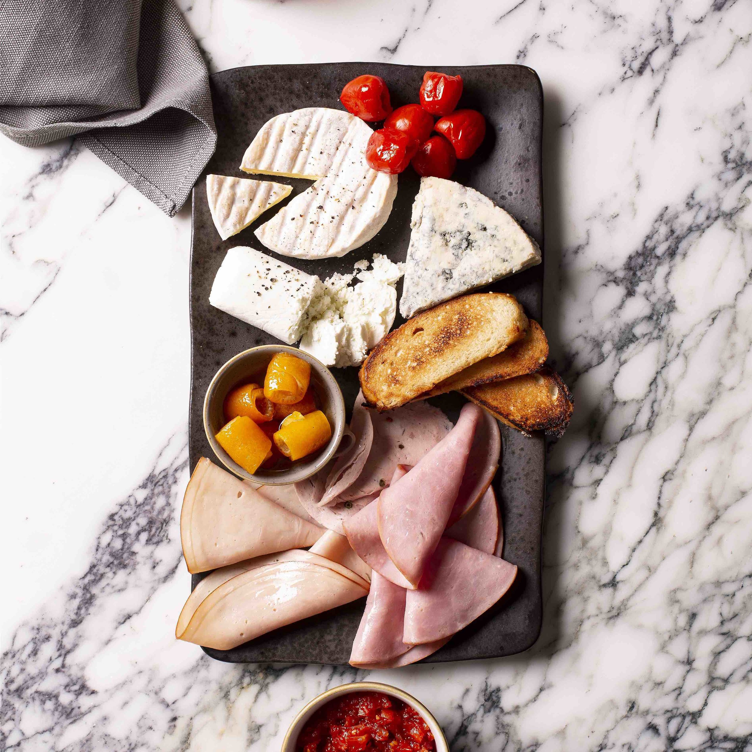 Charcuterie boardR 740 – - Hickory ham, salami and shaved turkey, assortment of South African cheeses, preserves, pickles, grilled vegetables and relishes