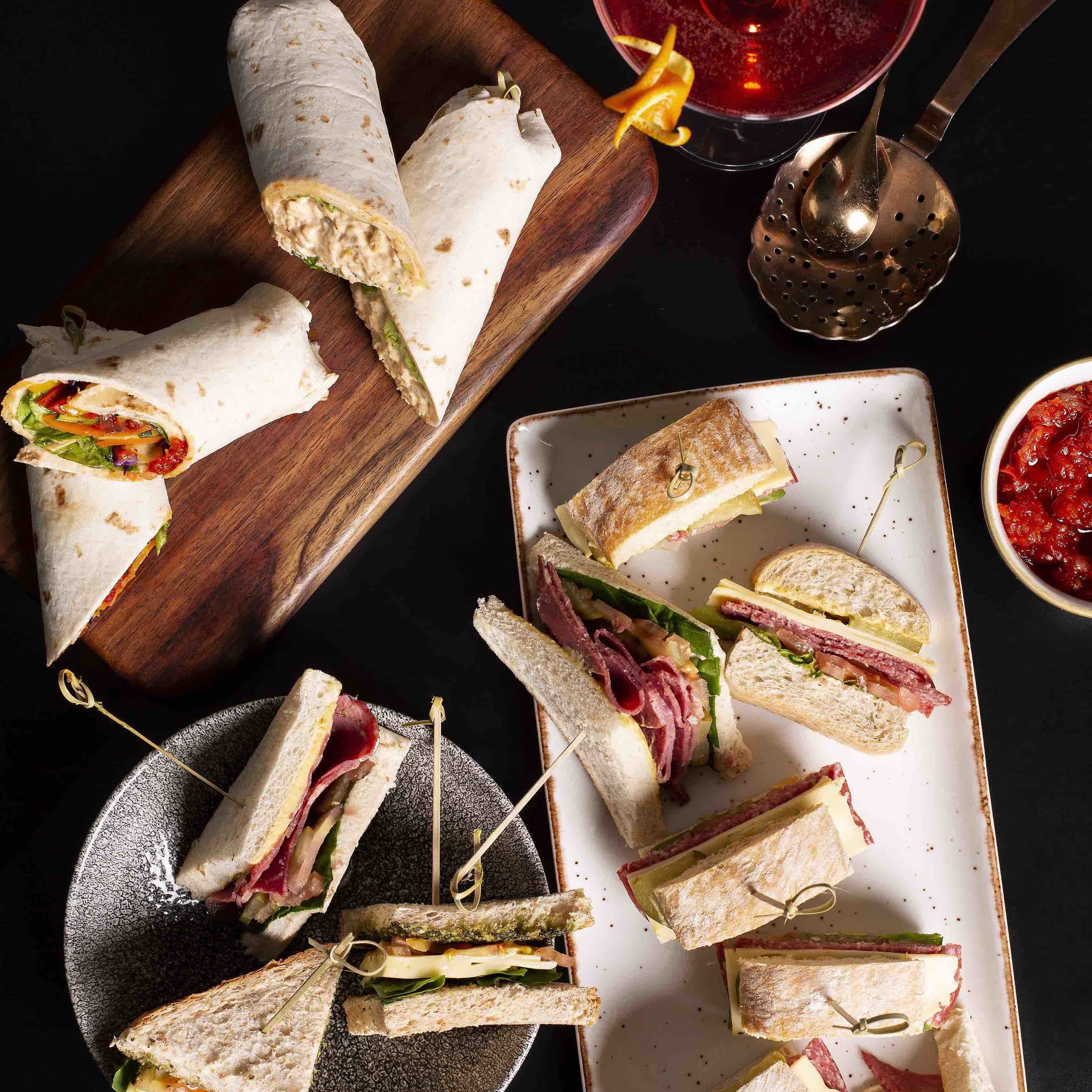 Sandwich PlatterR 580 – - Salami and white cheddar panini, spiced chicken and rocket wrap, mozzarella and tomato sandwiches with basil pesto, pastrami with mustard and pickles and Vegan grilled vegetable and baby spinach wraps with spicy tomato relish