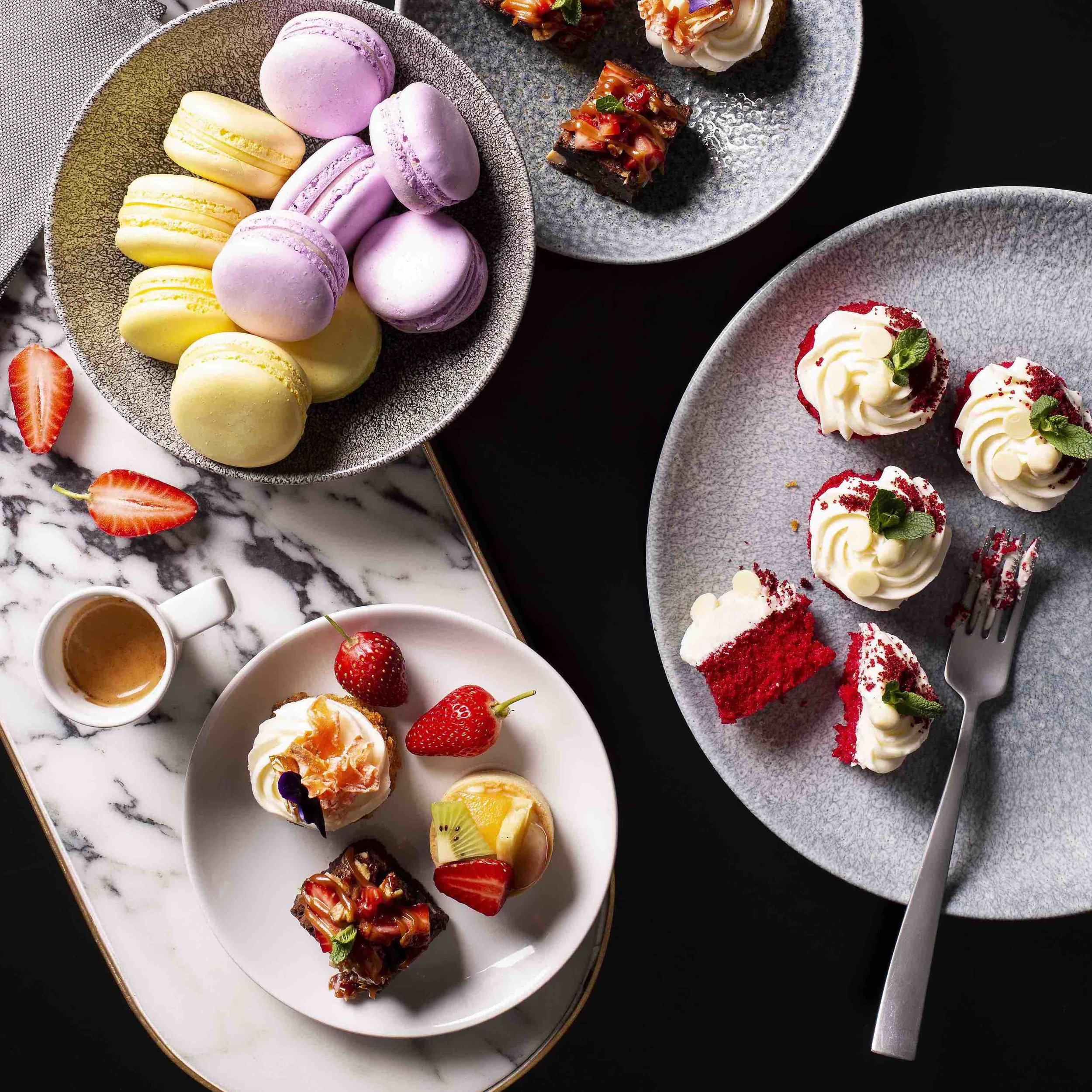 Dessert PlatterR 610 – - Decadent dark Chocolate brownies, fruit and custard tartelettes, red velvet cakes, assorted macaroons, carrot and apple cake.