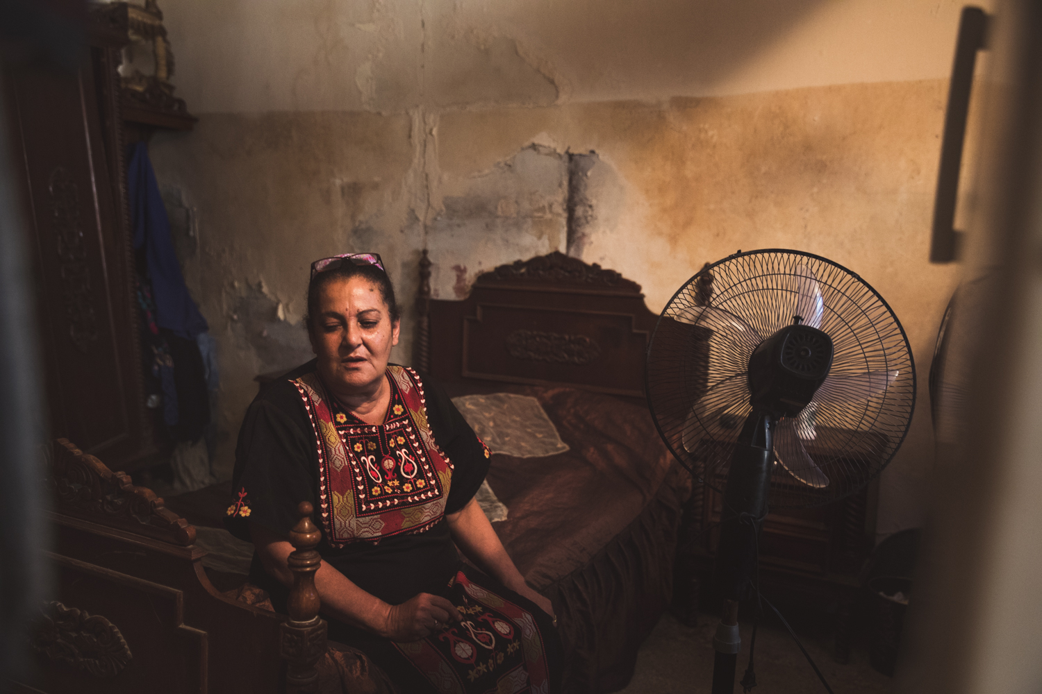 An elderly woman in her small room.