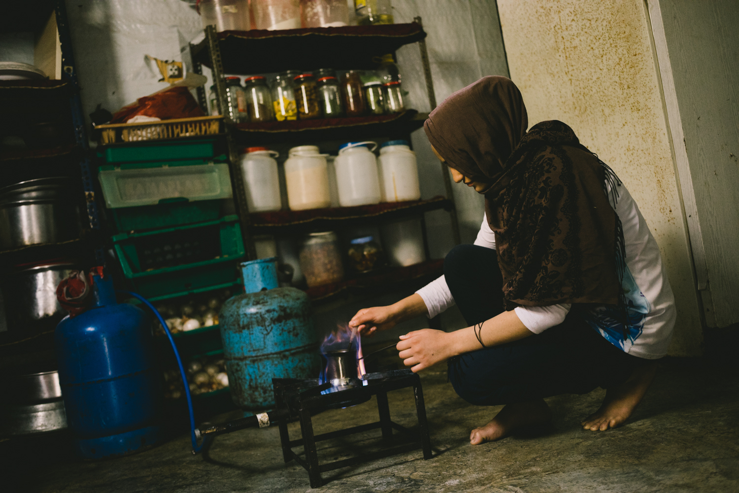 A teenage girl prepares coffee for her family.