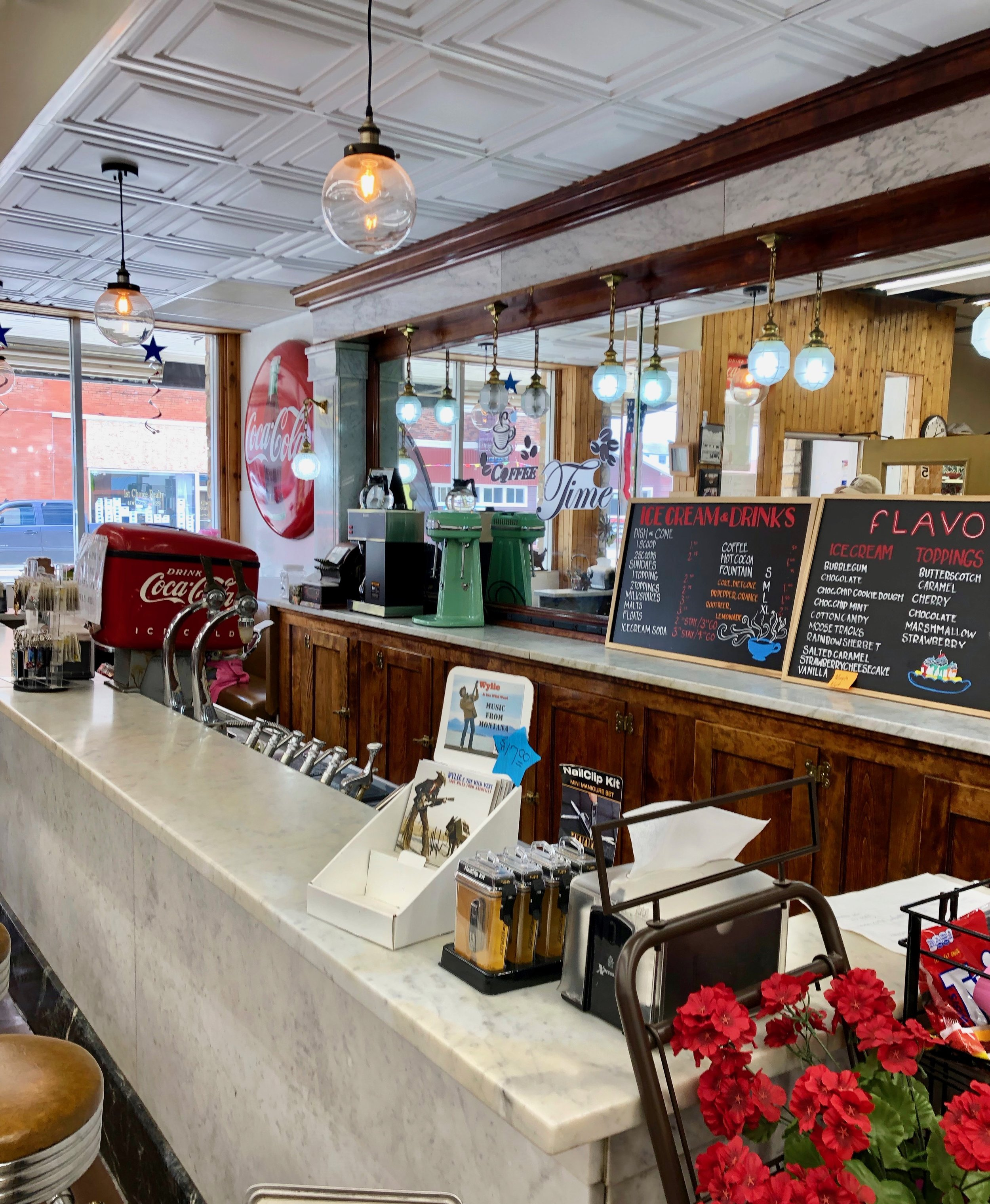 The oldest continuously running soda fountain in the United States, still open at Olson's Drug in Conrad, Montana.