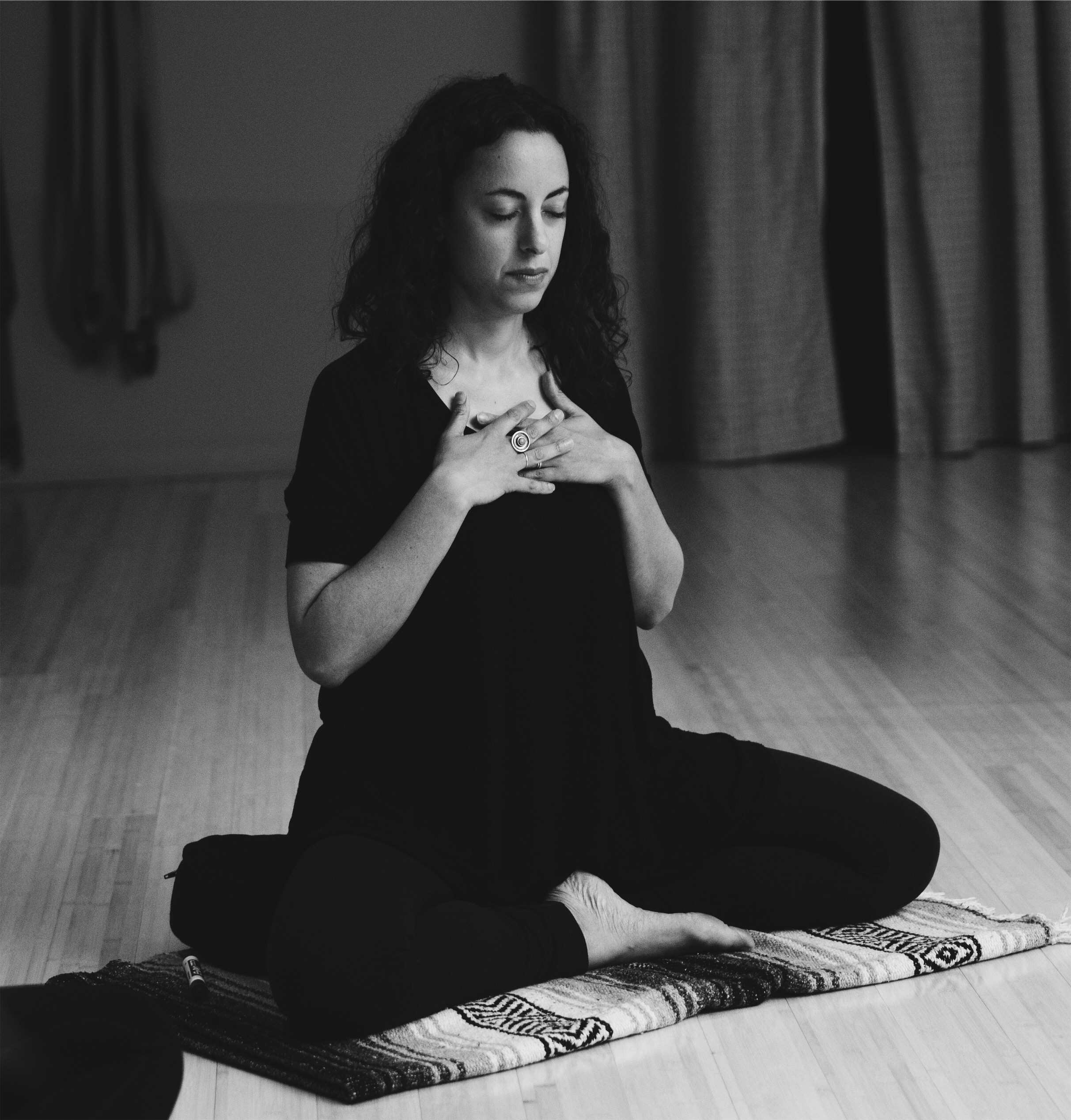 Sarah Capua - Sarah is a yoga therapist and meditation teacher, a student of Buddhism and classical yogic practice, and a caregiver. The heart of her practice is rooted in the tradition of T Krishnamacharya and TKV Desikachar, who emphasized individualized practice and believed that yoga should be adapted to foster self inquiry and personal transformation. She has been lucky to study deeply in this tradition at the Krishnamacharya Yoga Mandiram in Chennai, in training with her teacher Danielle Tarantola, and with many senior teachers of this lineage. She also studies meditation and Buddhist teachings with Michael Stone, as well as contemplative caregiving at New York Zen Center for Contemplative Care, where she serves as an end-of-life doula. Her contemplative practice is also linked to her artistic practice as co-director of contemporary dance company a+s works. She lives in Beacon, NY with her painter husband and teaches throughout NYC and the Hudson Valley.