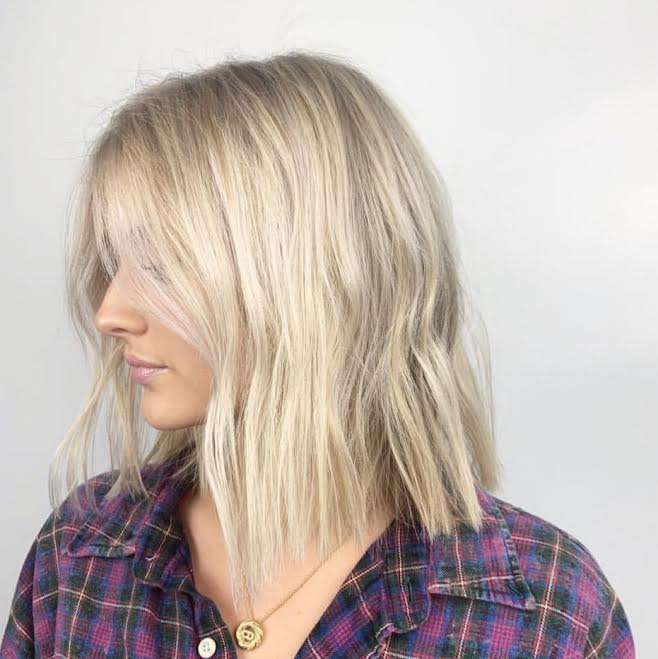 Bright blonde by @xanthi.hair in our Nashville salon location