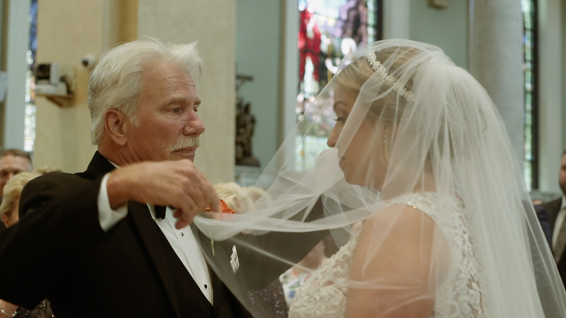 Father of the Bride lifts veil