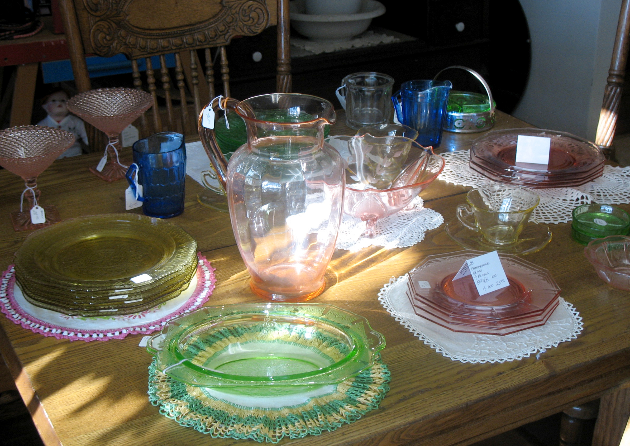 Depression Glass pieces pictured above include: Pink Cambridge Glass Plates, Cobalt Aurora Creamer, Amber Patrician Luncheon Plates, Pink Cherry Blossom Berry Bowl, Green Princess Oval Vegetable Bowl