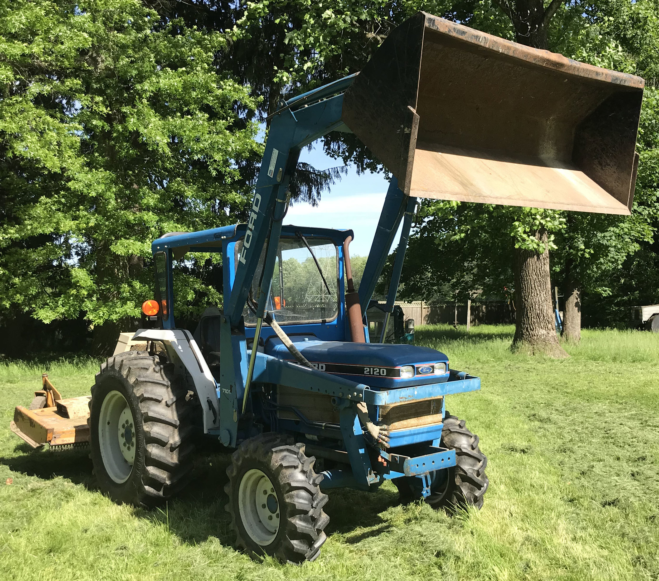 1990/1991  Ford 2120 Compact Utility Tractor  : approx. 860 hrs, 4 cylinder diesel engine, 12 x 12 transmission, 4 wheel drive, hydraulics, 3 pt. hitch, PTO, ROPS, Model 7109 front end loader, Curtis cab., 14.9–26 rear tires, 9.5-16 front tires, Model #AV413P, tractor serial #UV24193.