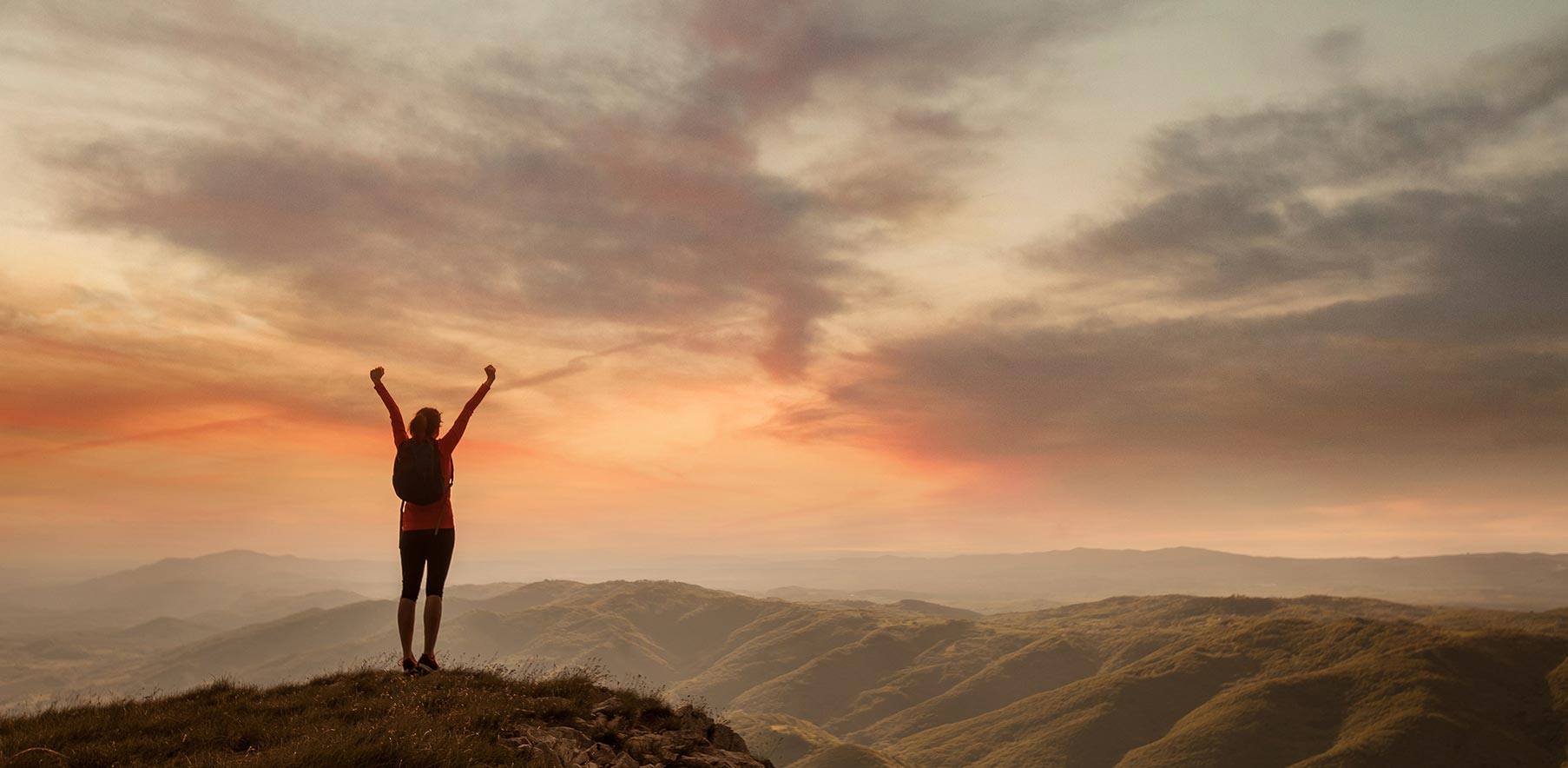 triumphant-woman-on-top-of-hill-sunset-1.jpg