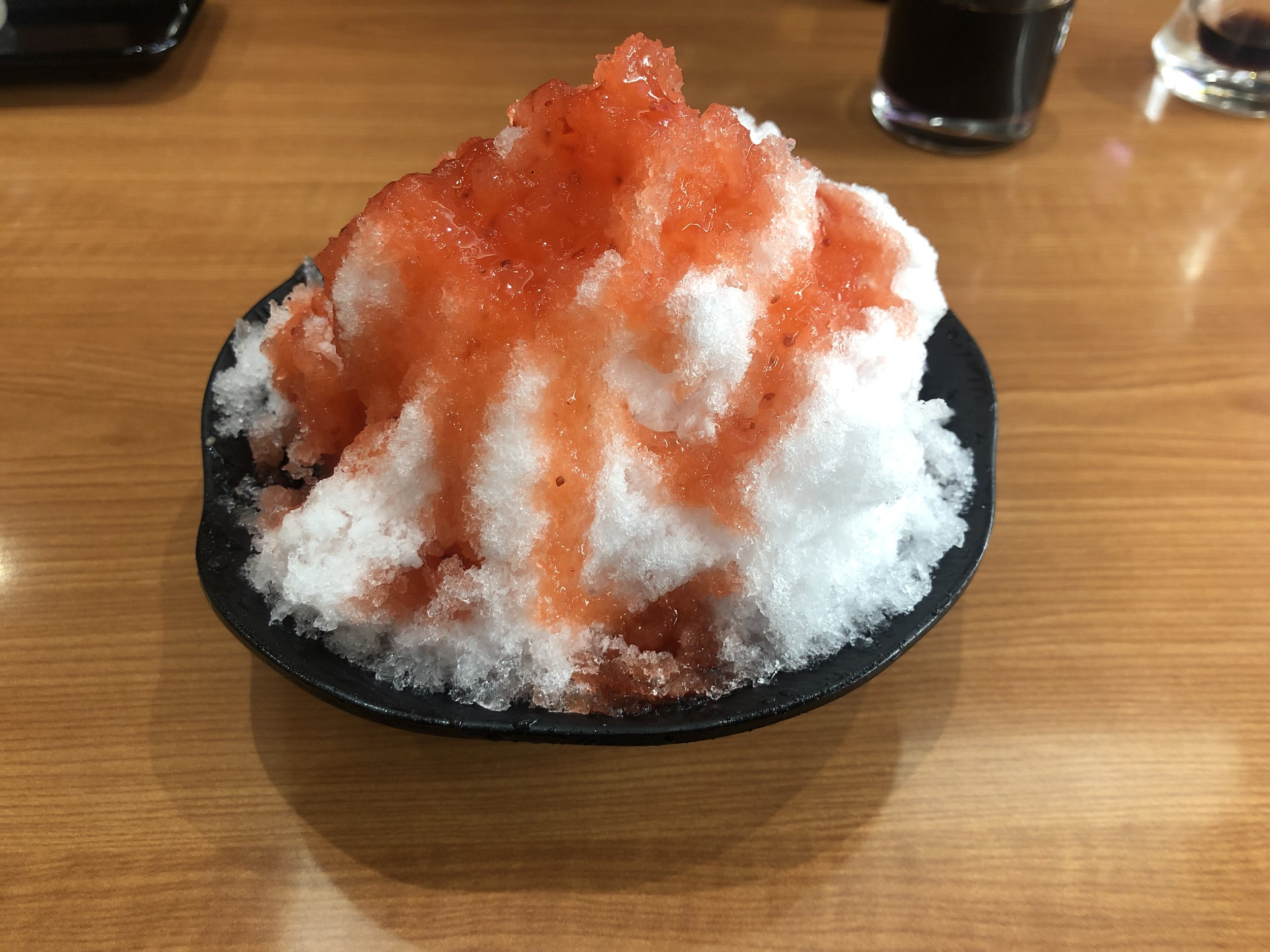 Andy recommended I try this and DAMN I'm glad I did. It shaved ice, but the softest, smoothest, lightest, sweetest ice I've ever tasted. Fresh strawberry…stuff.. on top made it one of my favorite desserts.