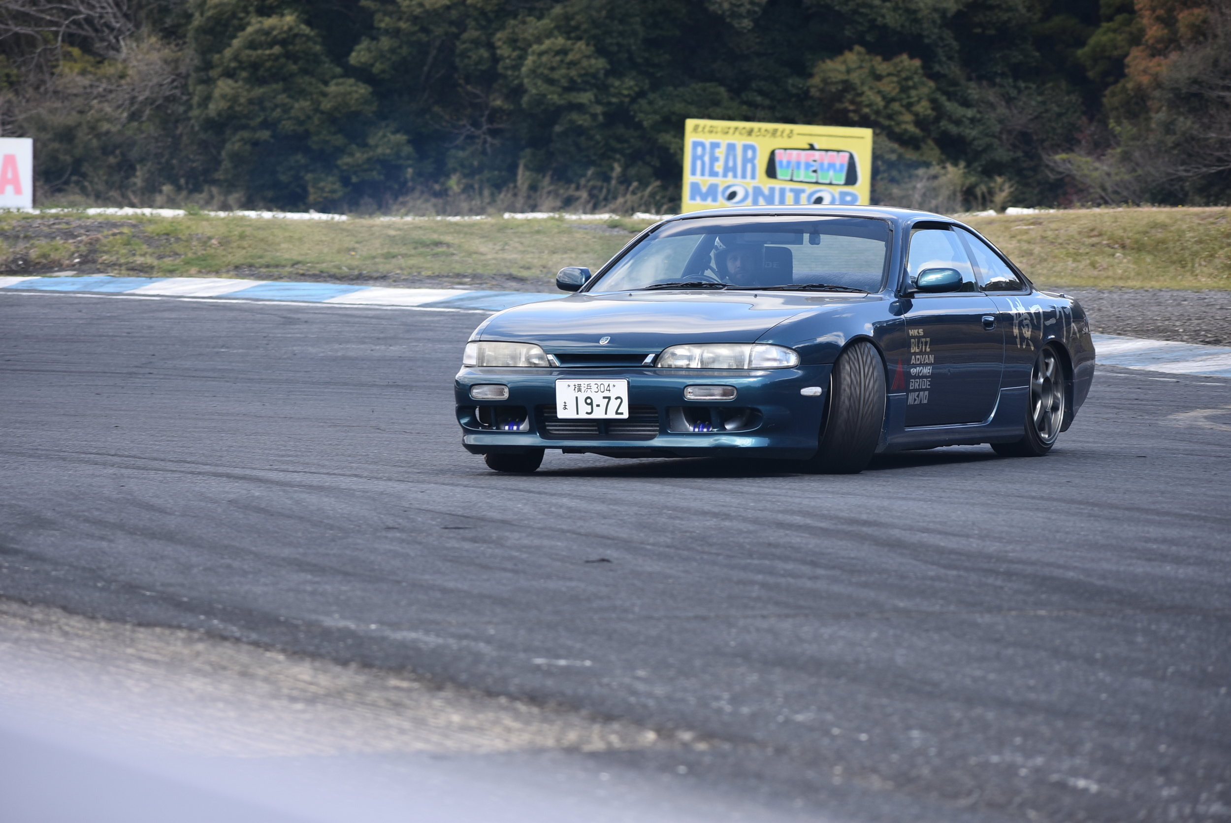 It was odd to see another American at a random track day, but it was equally as awesome! He was from Texas and had been living in Japan for quite some time. His style with his S14 was spot on. Big fan of all the AVS wheels, and matching drift spares!