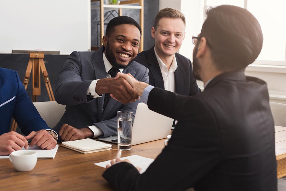 business-handshake-at-multiethnic-office-meeting.jpg
