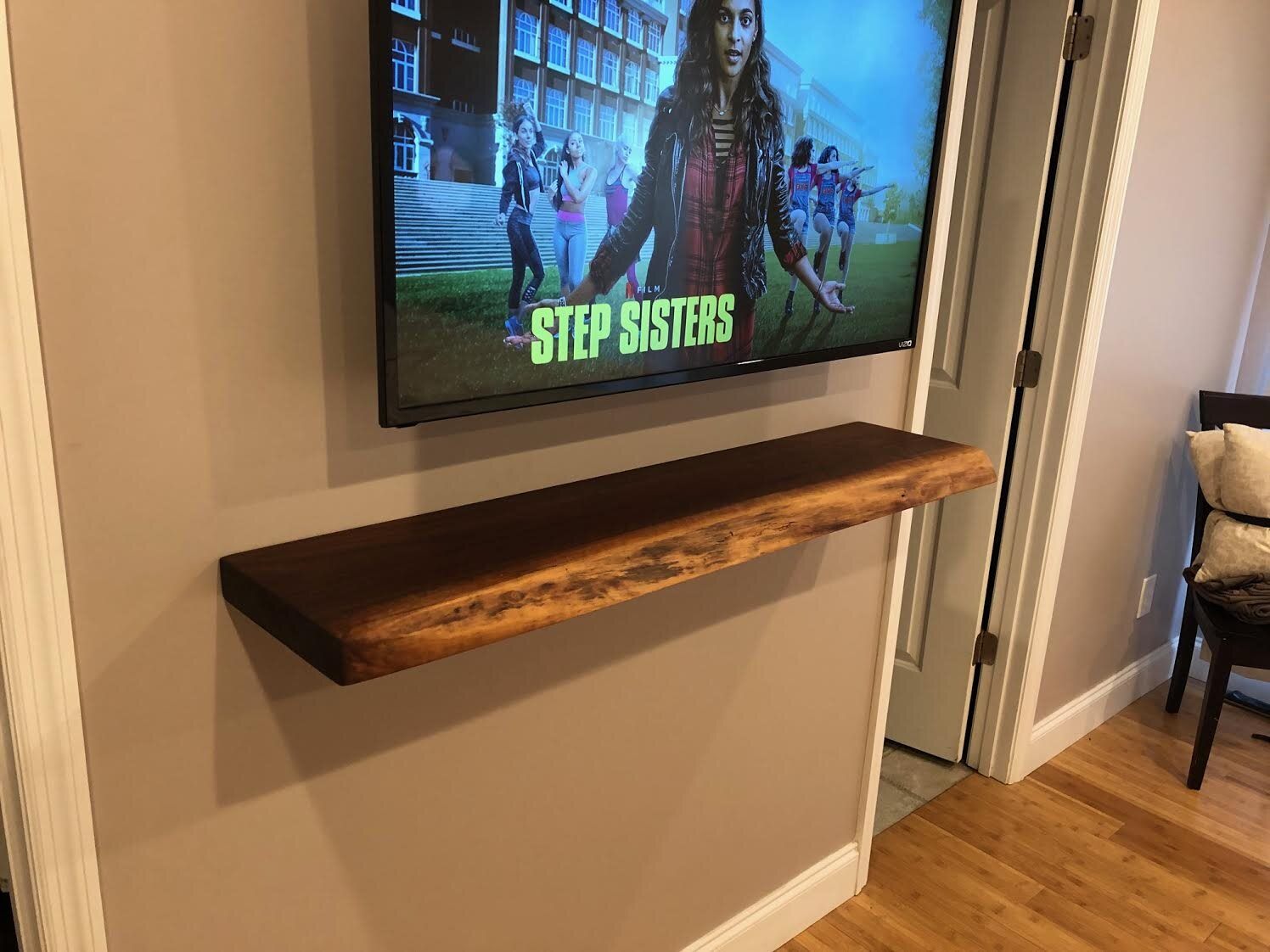 Live edge floating shelf hung with floating shelf bracket